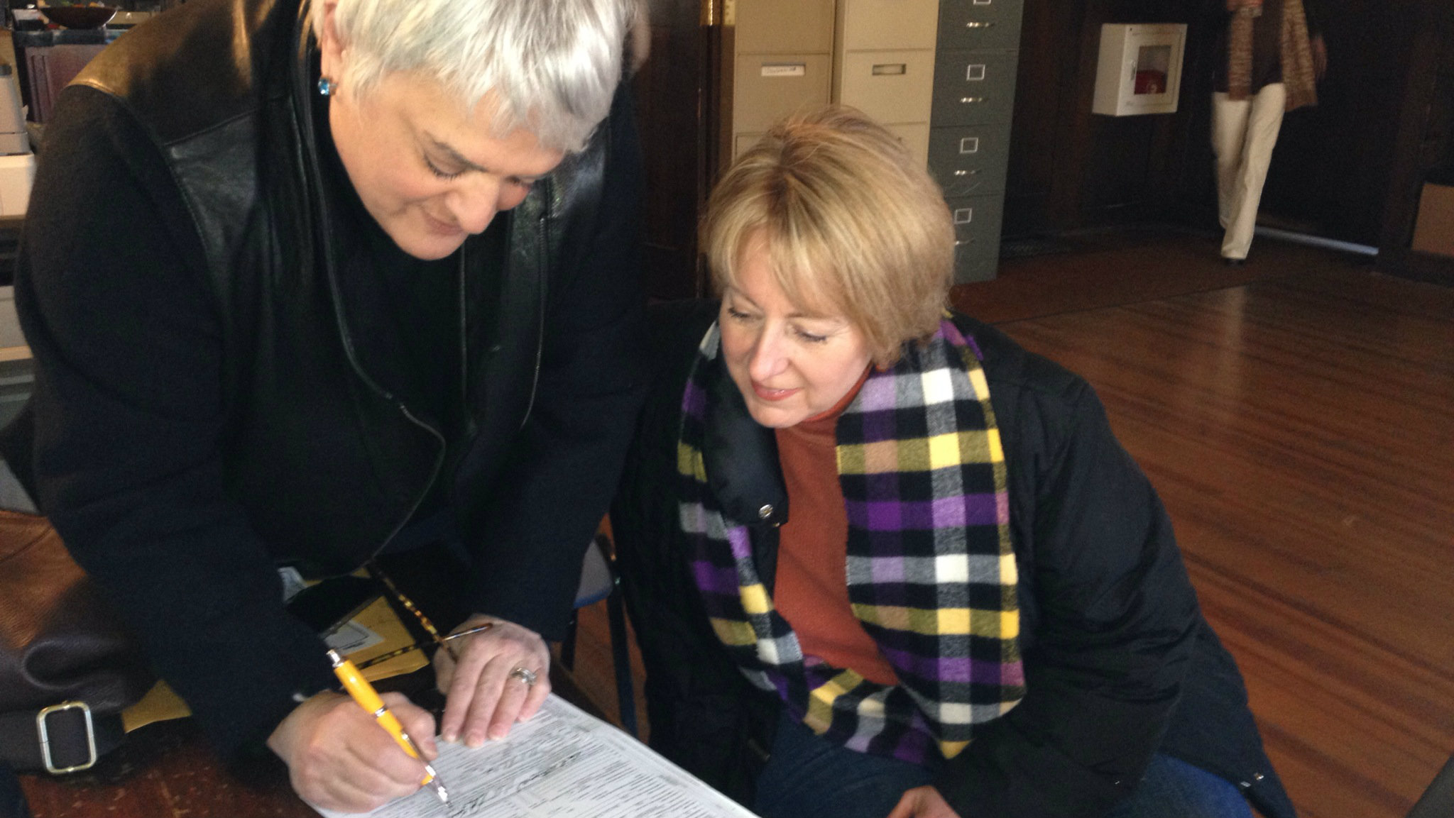 <p>Kris and Nan McDaniel-Miccio sign their marriage license after being wed in New York in 2013.</p>