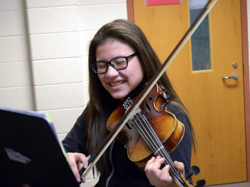 <p>14-year-old Mayerli Lopez plays the violin at Bruce Randolph School in Denver.</p>
