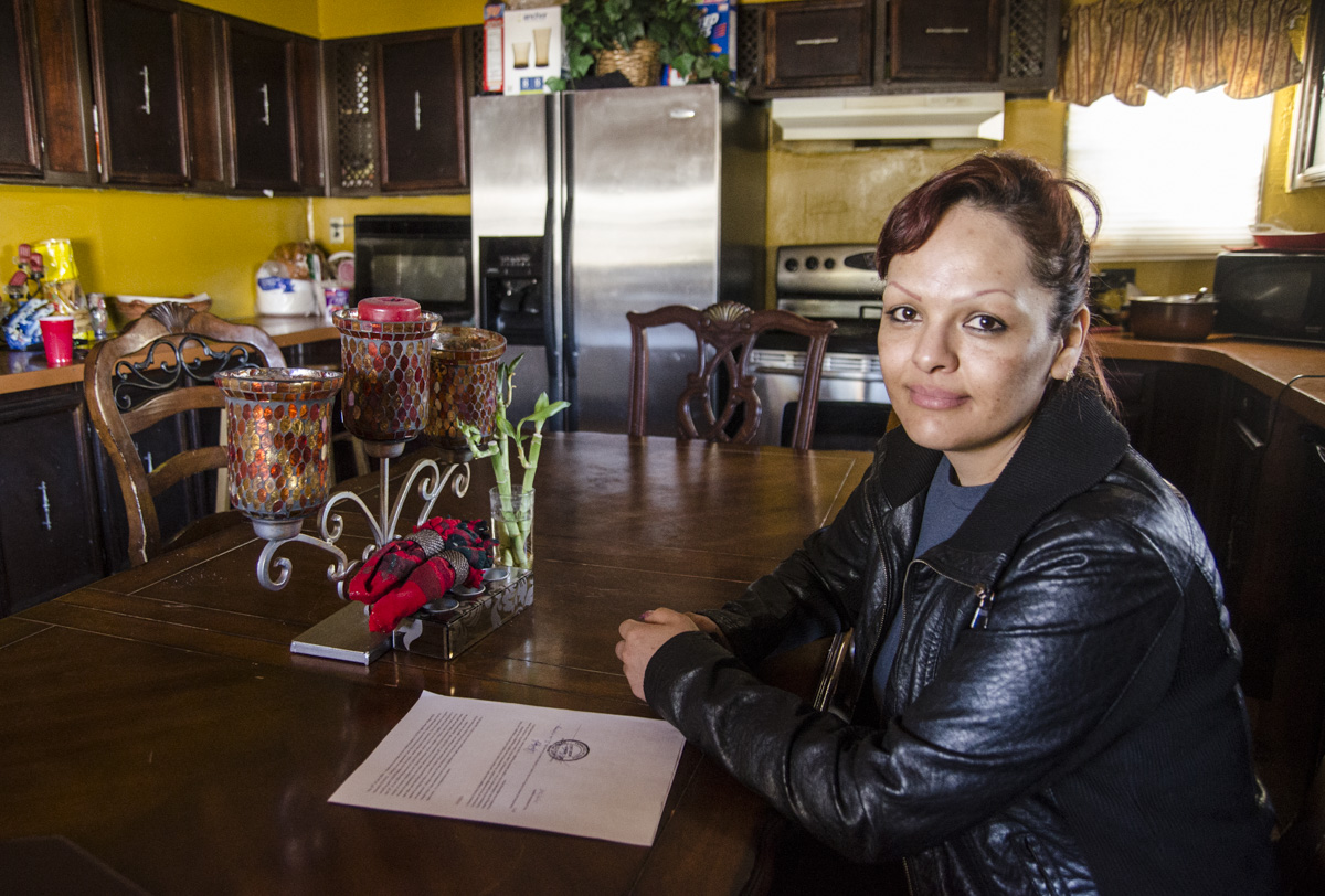 <p>Erika Gonzalez sits in the kitchen of the trailer she shares with another family and a boarder in Edwards, Colo. on Friday, Feb. 6, 2015. On the table is a notarized legal document she needs to prove her ownership of the trailer, which she recently paid off after 10 years of payments.</p>