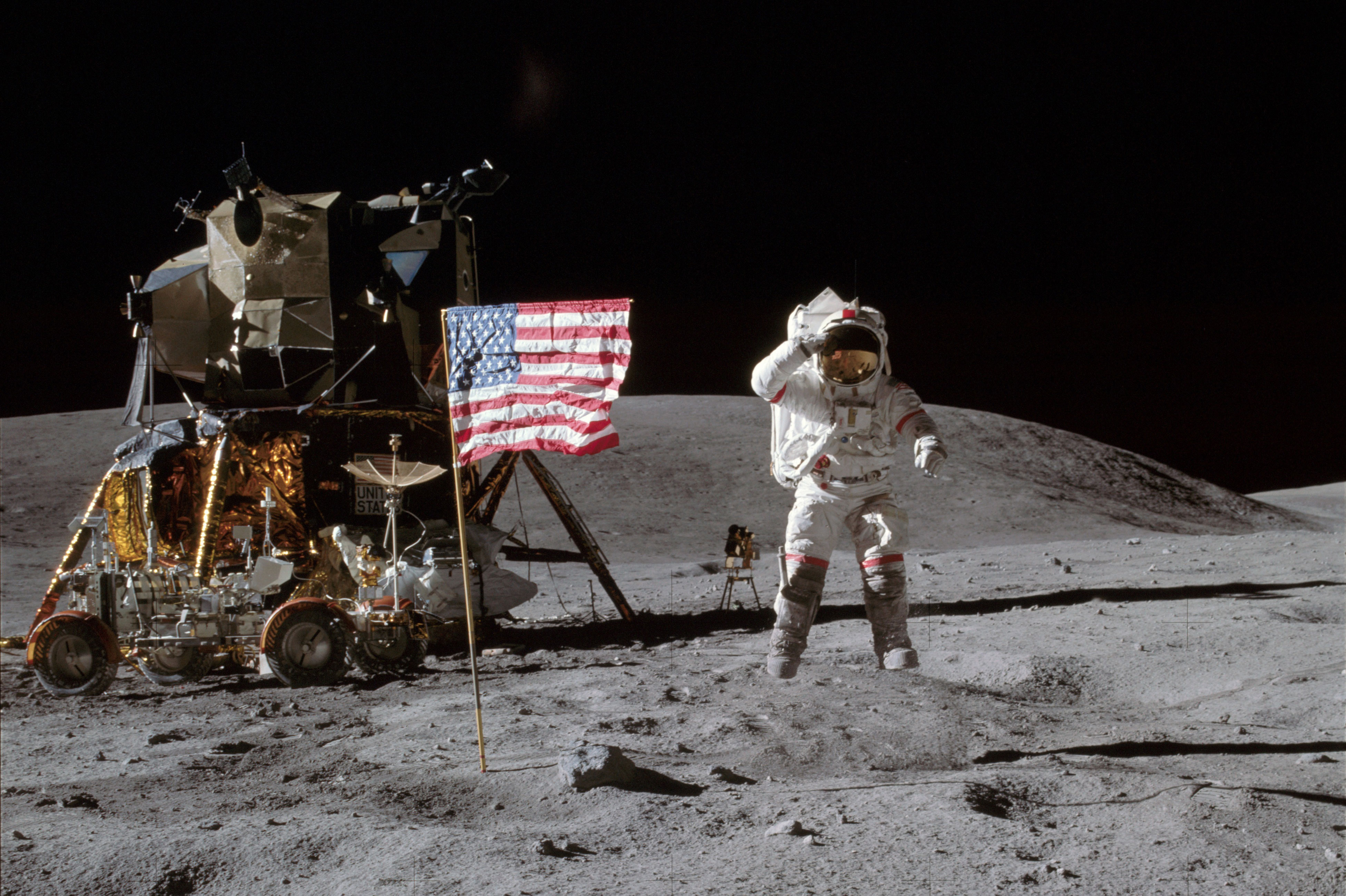 <p>Astronaut John W. Young, commander of the Apollo 16 lunar landing mission, leaps from the lunar surface as he salutes the United States flag at the Descartes landing site for Apollo 16, April 20, 1972.</p>