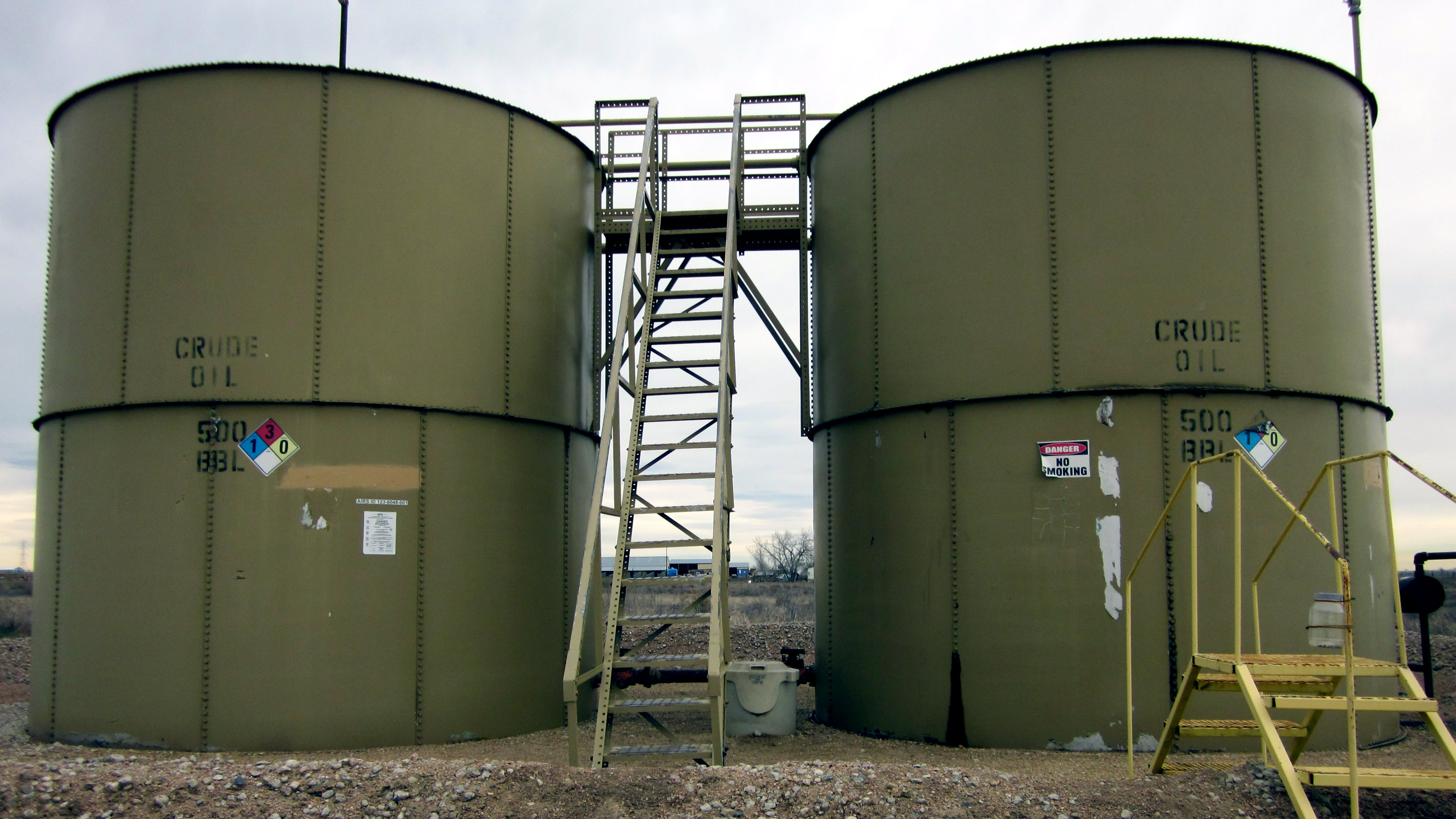 <p>Large tanks like these in Weld County are used to store oil. </p>