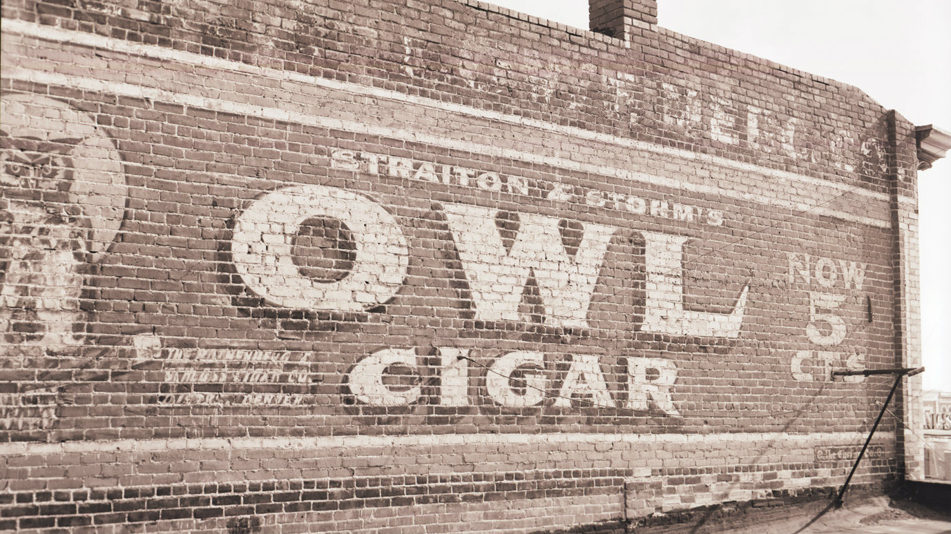 <p>The historic Owl Cigar sign is painted on a masonry wall in Fort Collins.</p>