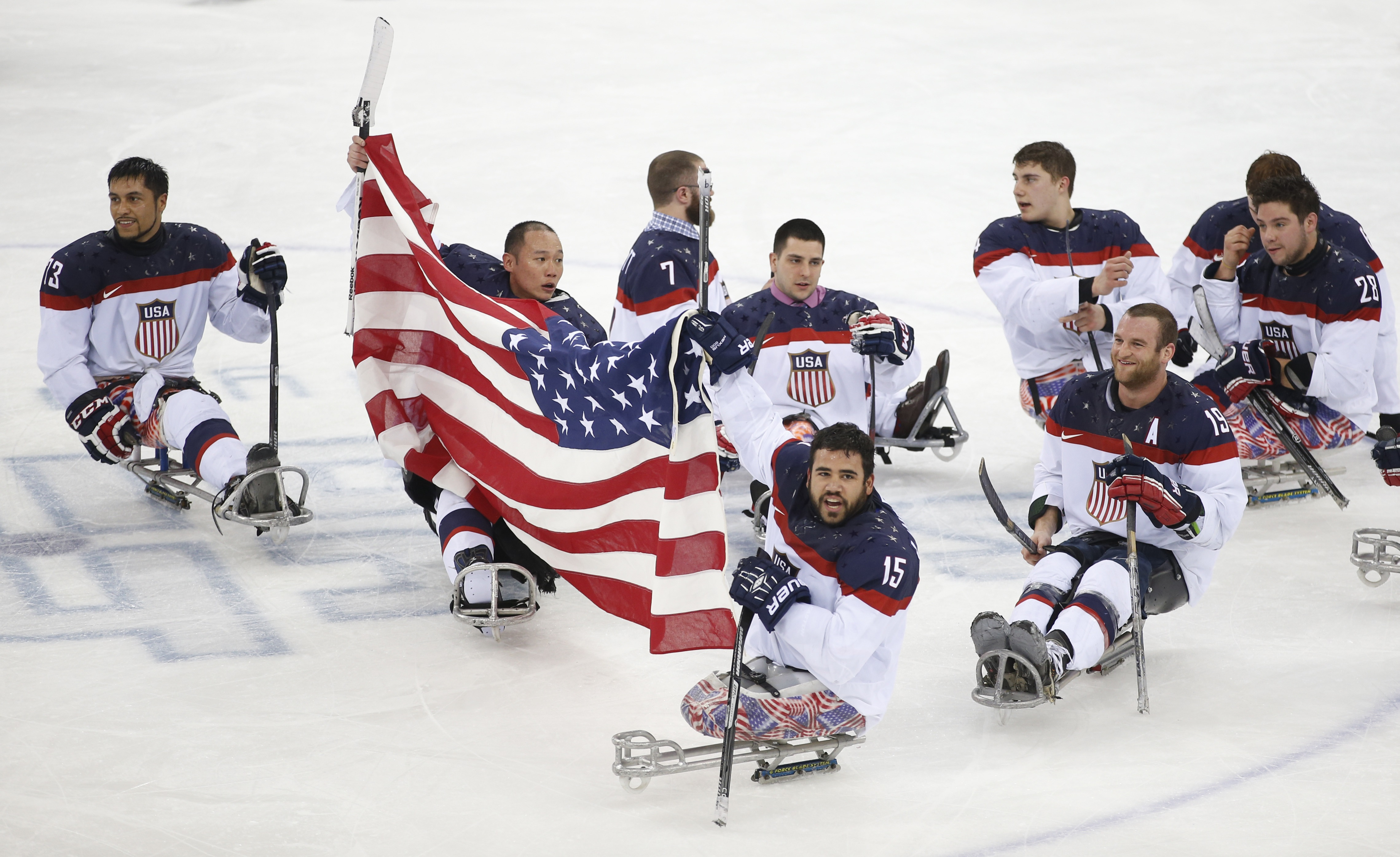 <p>U.S. Paralympic hockey players, including Nikko Landeros in the Number 15 jersey, celebrate their win at the 2014 games in Sochi, Russia.</p>