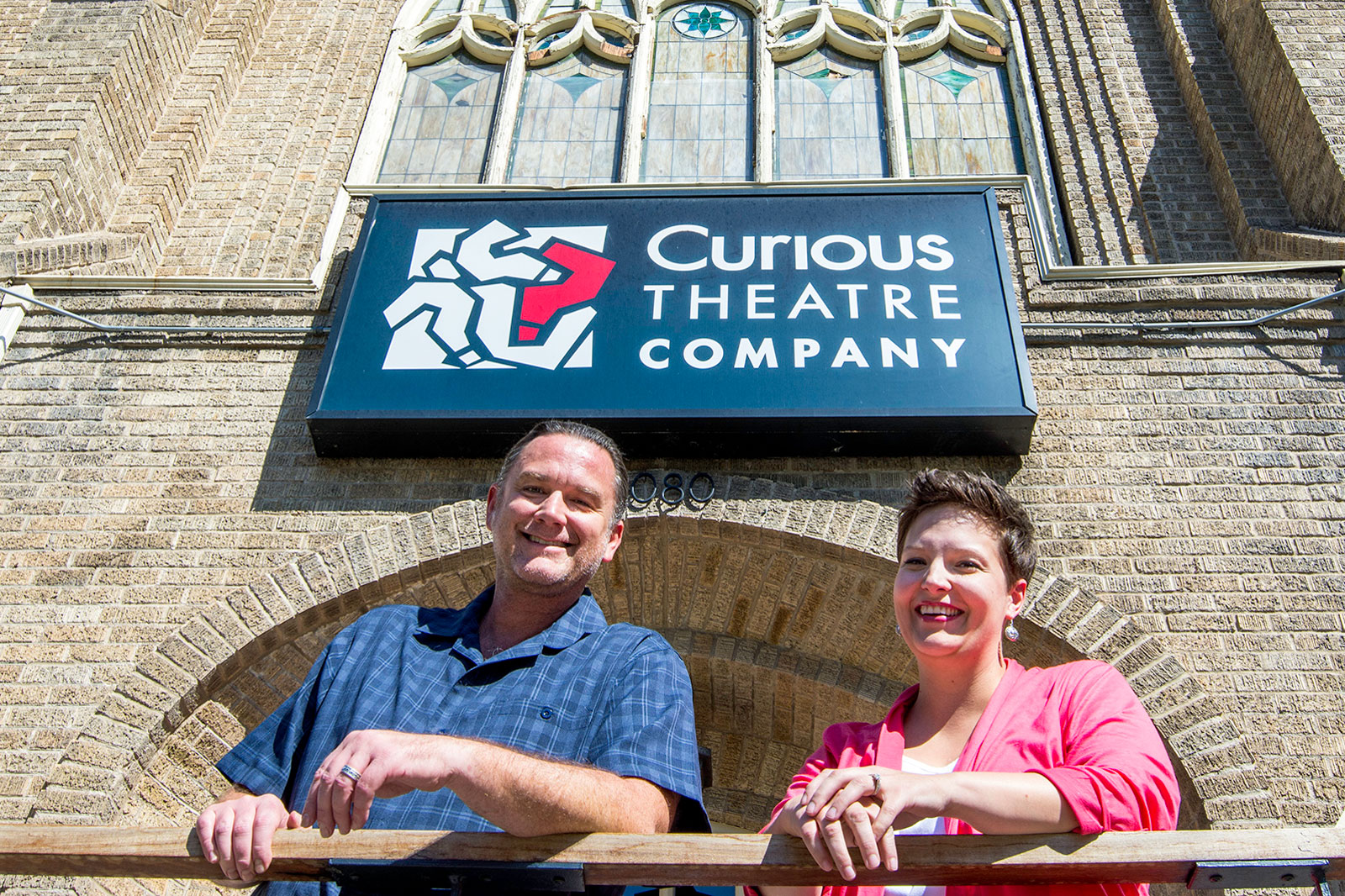 <p>Producing artistic director Chip Walton (left) and managing director Katie Maltais stand outside the 1893 church that has served as Curious Theatre Company's home for 20 years.</p>