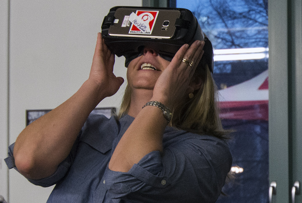 """<p>Nicole Garneauof Denver watches the interactive virtual reality film """"Wild Animal Vision""""at the McNichols Civic Center Building on Saturday, Nov. 4, 2017.</p>"""