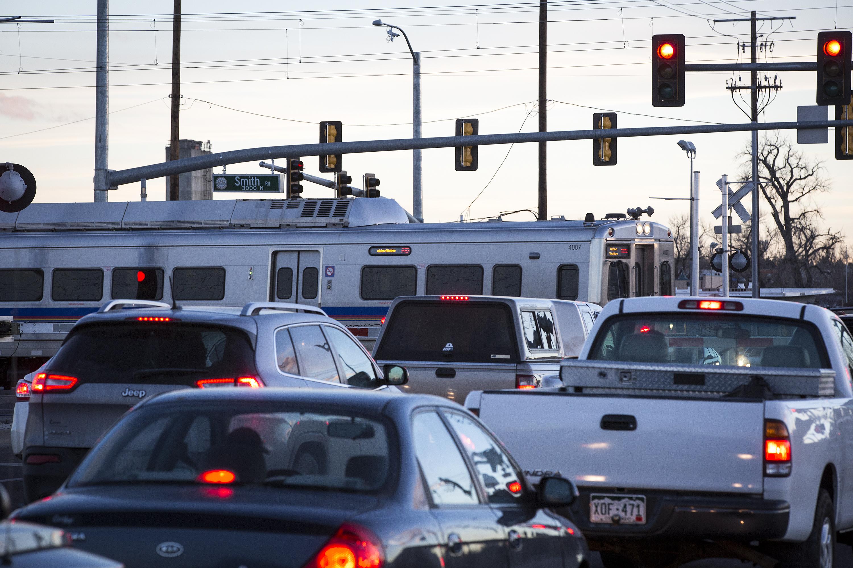 <p>As rush hour traffic waits, anA Line train crosses Chambers Road atSmith Roadin Aurora On Monday, Jan. 7, 2018.</p>
