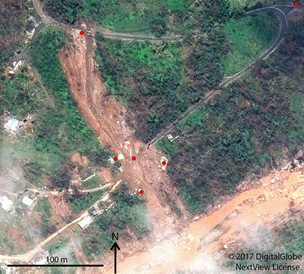 <p>Excerpt of a satellite image showing landslide impacts to a highway and houses near the Rio Blanco in Puerto Rico's Lares municipality. Points identify the approximate location of roads and buildings visibly impacted by landslides.</p>
