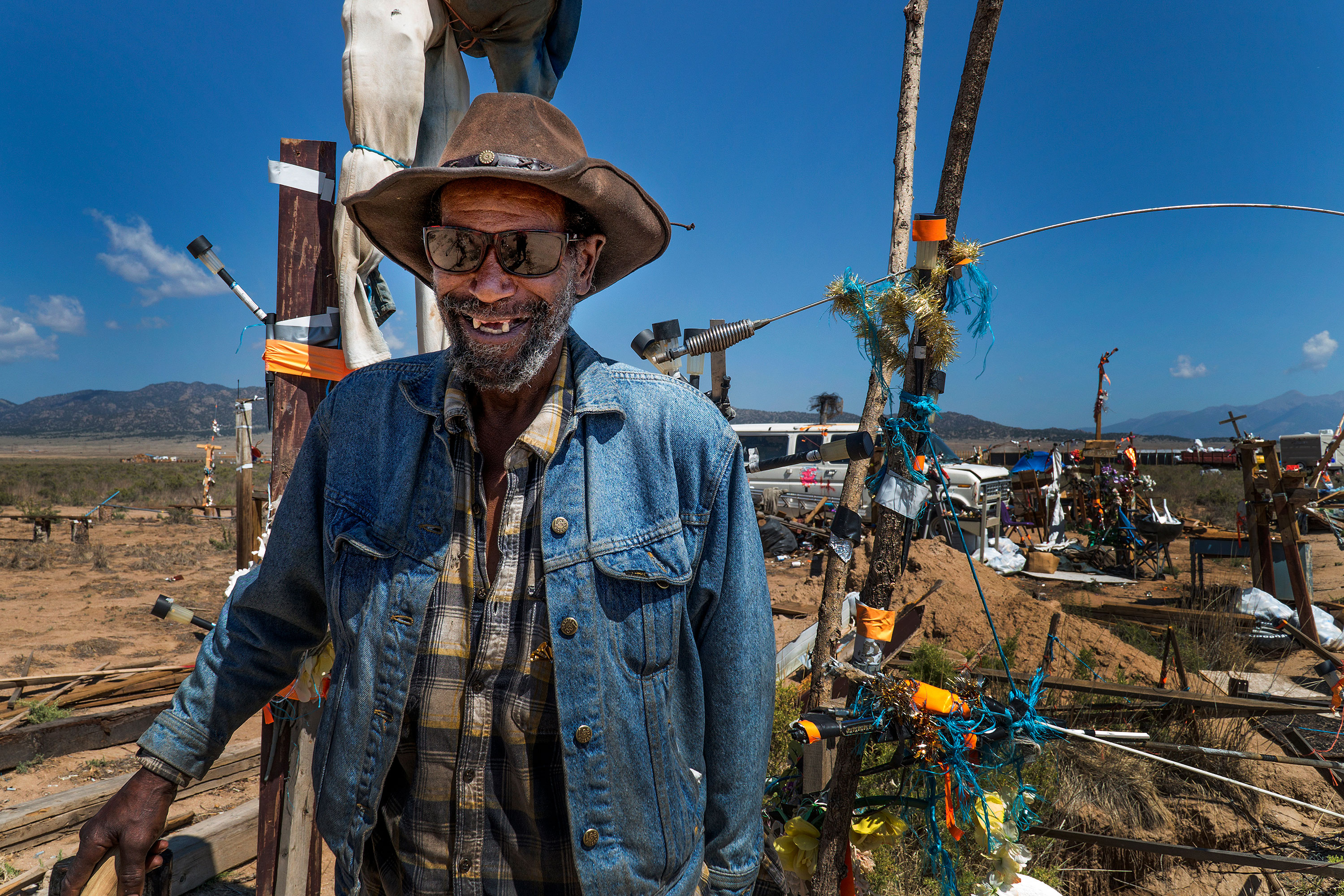 "<p>Roy L. Smith, known to many as ""Ramblin' Roy,"" at Fort Roy at Royville, about 20 minutes outside of Saguache, on July 31, 2018. He said it took him a little more than a year to build this art compound.</p>"