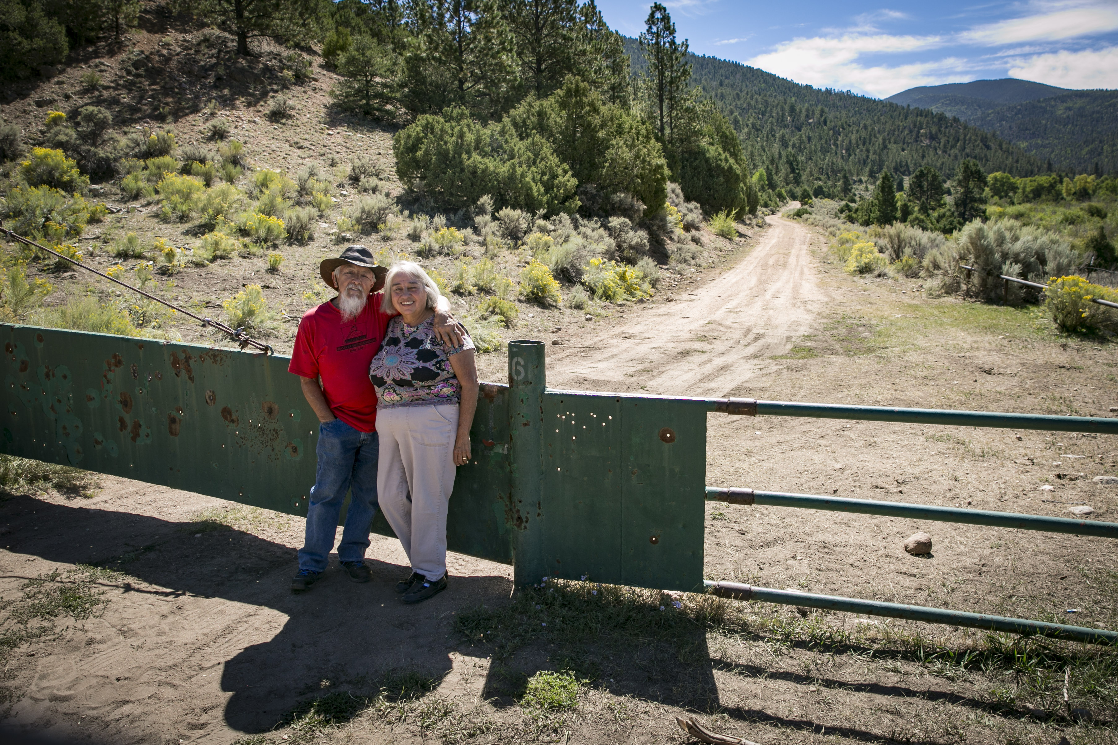 <p>Jose Martinez and his wife Juanita stand near a gate that allows them access to the Cielo Vista Ranch in CostillaCounty, Colorado.</p>