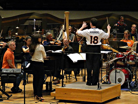 <p>Scott O'Neil, the Colorado Symphony's former resident conductor,wearshis Peyton Manning jersey during a January 2013 rehearsal.</p>