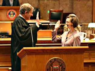 <p>Colorado Chief Justice Michael Bender administers the oath of office to Sen. Rachel Zenzinger, D-Arvada.</p>