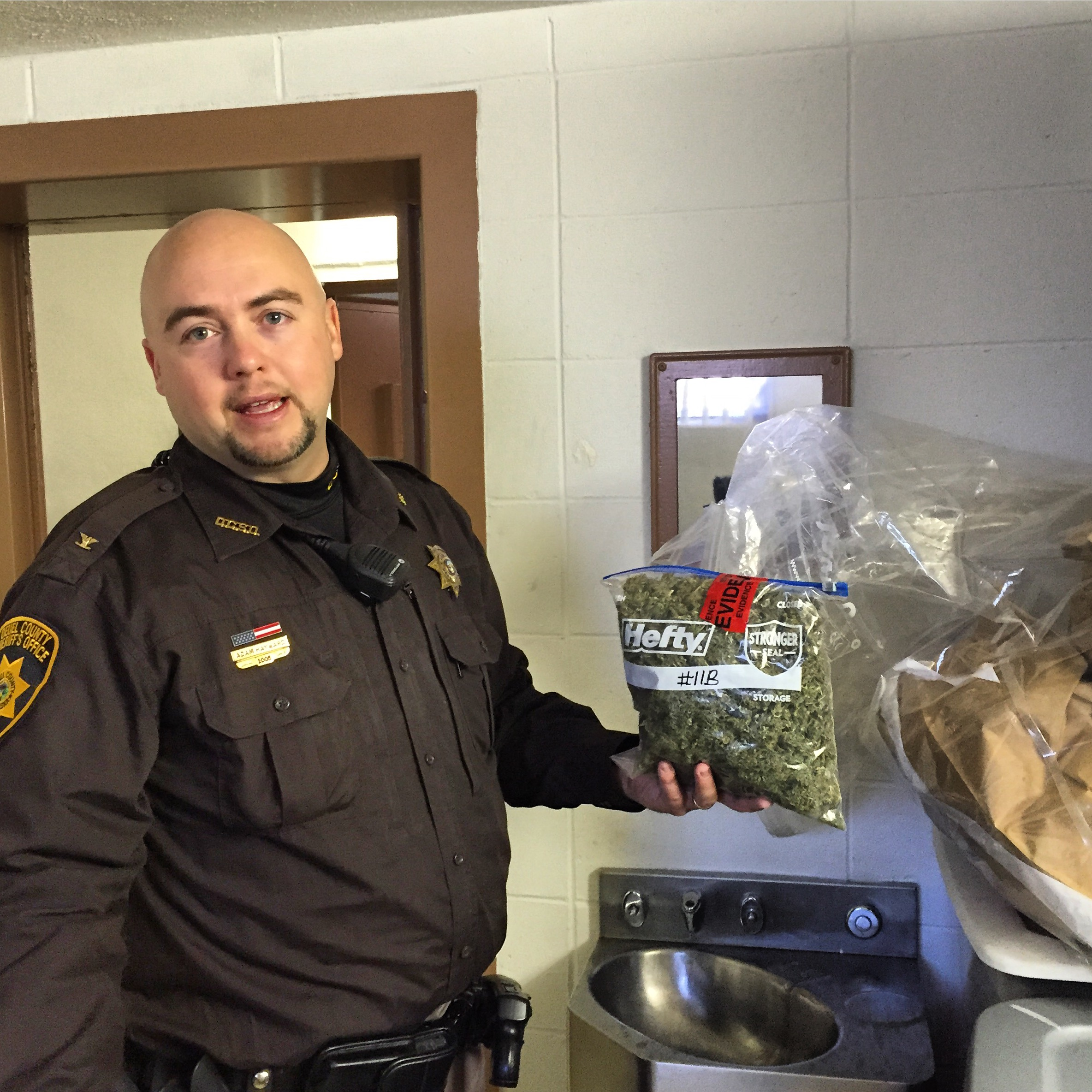 """<p>Deuel County, Neb. Sheriff Adam Hayward in his evidence room, a former jail cell.About 80 lbs of marijuana is stored there from recent arrests. """"90 % of this came from Colorado,"""" Hayward says.</p>"""