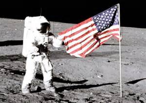 <p>Apollo 12 astronaut Charles Conrad Jr. stands beside the United States flag after it was unfurled on the lunar surface in 1969.</p>