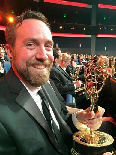 <p>Tim Kimmel sits with his Emmy.</p>
