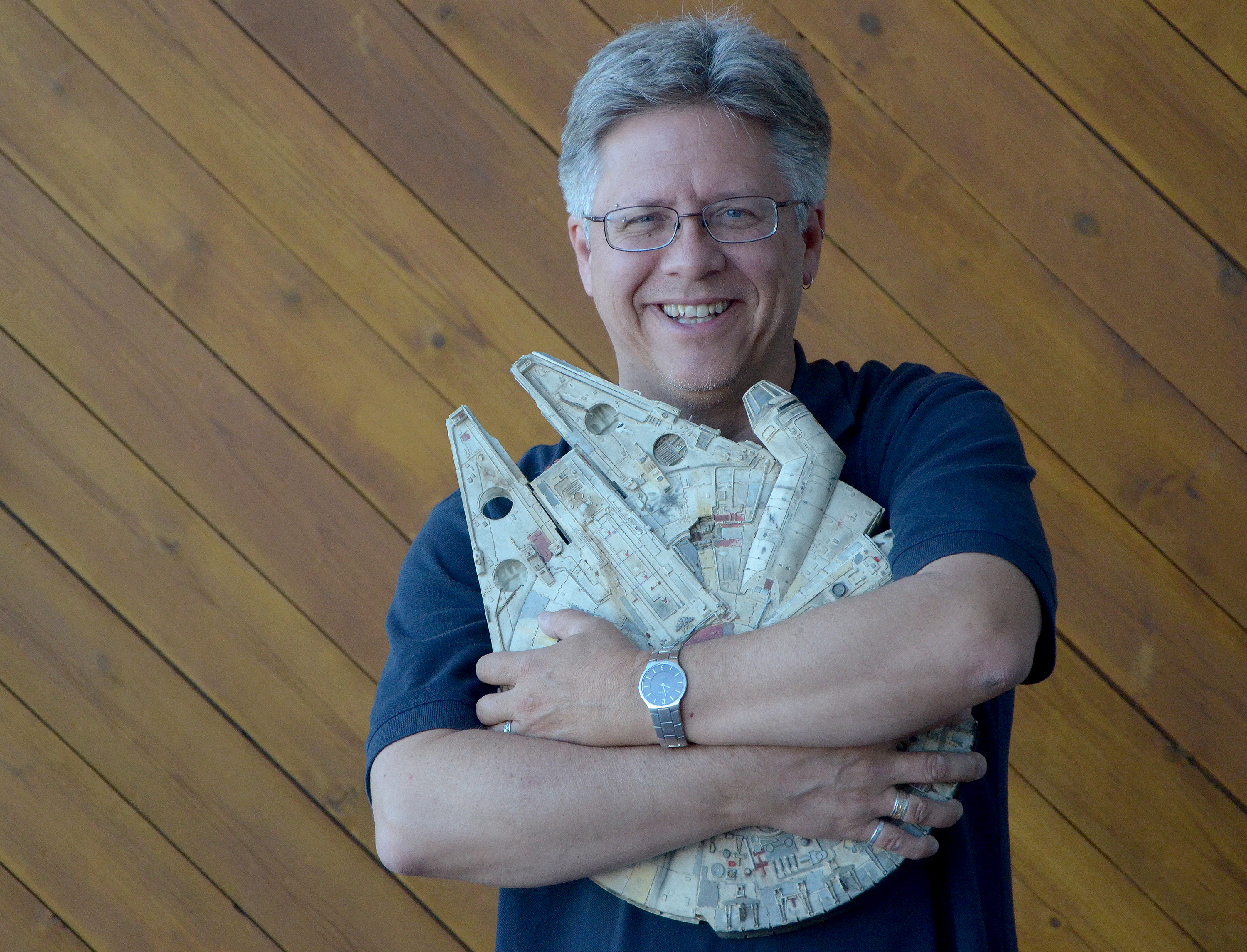 """<p>Thomas Carr, anarchaeologist for History Colorado, with his prizedmodel Millenium Falcon from """"Star Wars"""" at the CPR studios.</p>"""