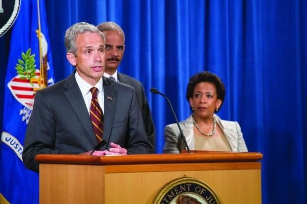 <p>Former U.S. Attorney John Walsh, at the podium, with then-Attorney General Eric Holder and current Attorney General Loretta Lynch.</p>