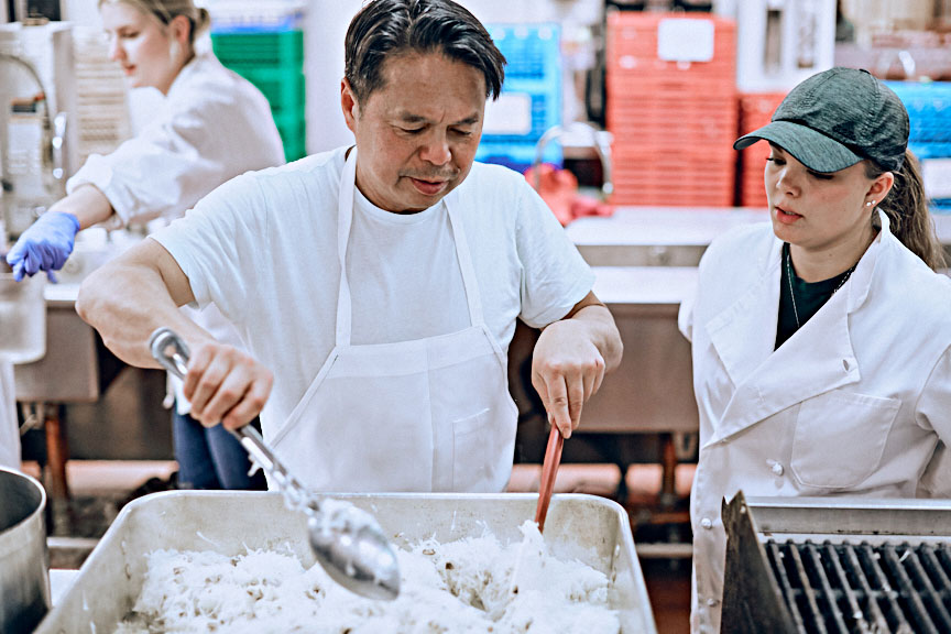 Chef Charles Phan, of The Slanted Door restaurant in San Francisco, oversees dinner preparations at the University of Denver's Fritz Knoebel School of Hospitality Management. (Courtesy Andy Bonura)