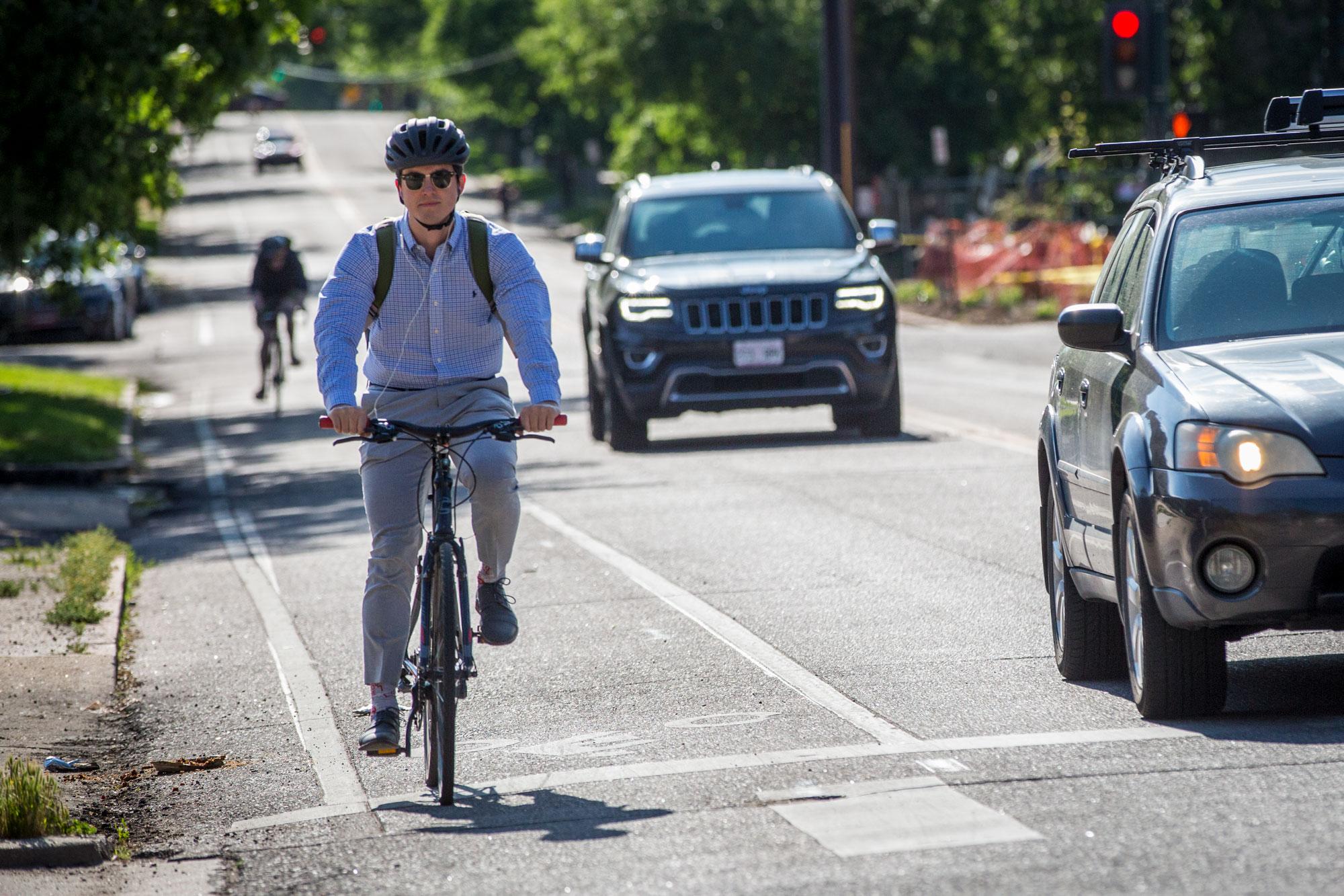 <p>Bike commuters in Denver June 12, 2019.</p>