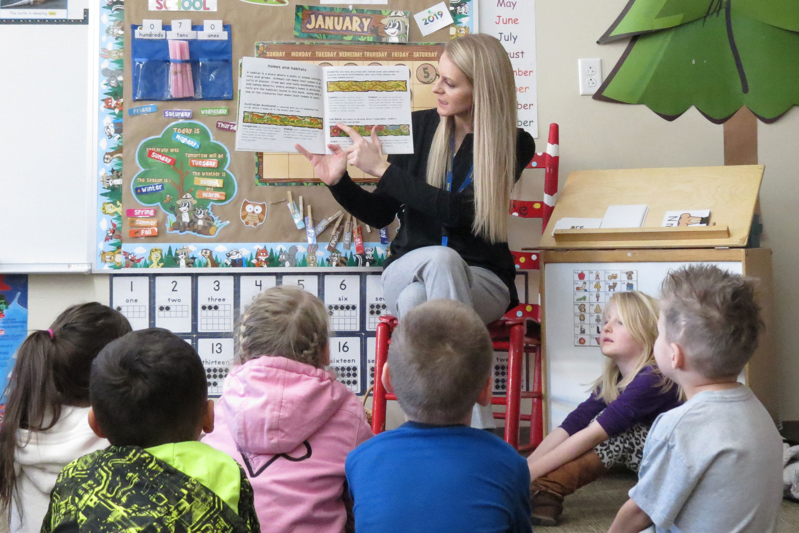 Simla Elementary School kindergarten teacher Holly Koehn reads to her class. Simla Elementary is part of the rural Big Sandy School District in rural Elbert County.