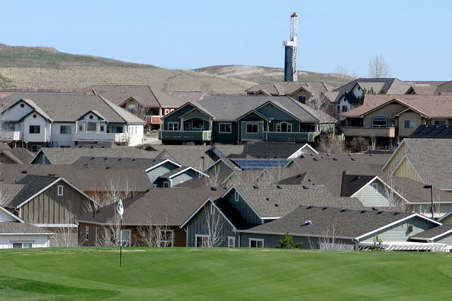 <p>The view from the Colorado National Golf Club includes housing developments and a drilling rig in Erie, Colorado on April 8, 2019.</p>