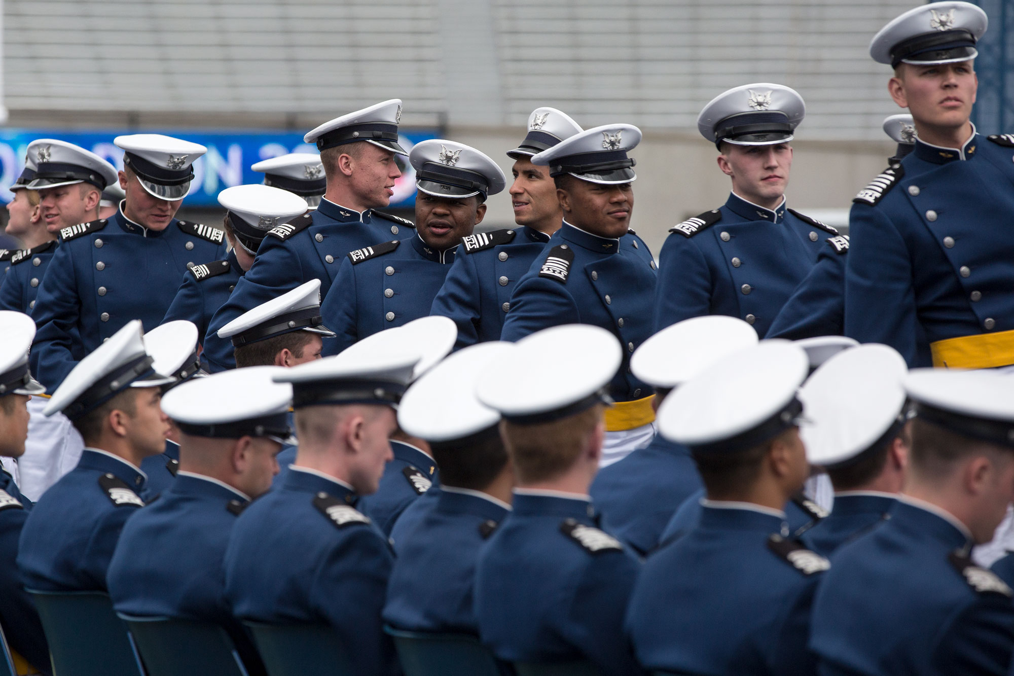 <p>U.S. Air Force Academy graduates line up to collect their diplomas and shake hands with President Donald Trump at the commencement ceremony Thursday, May 30.</p>