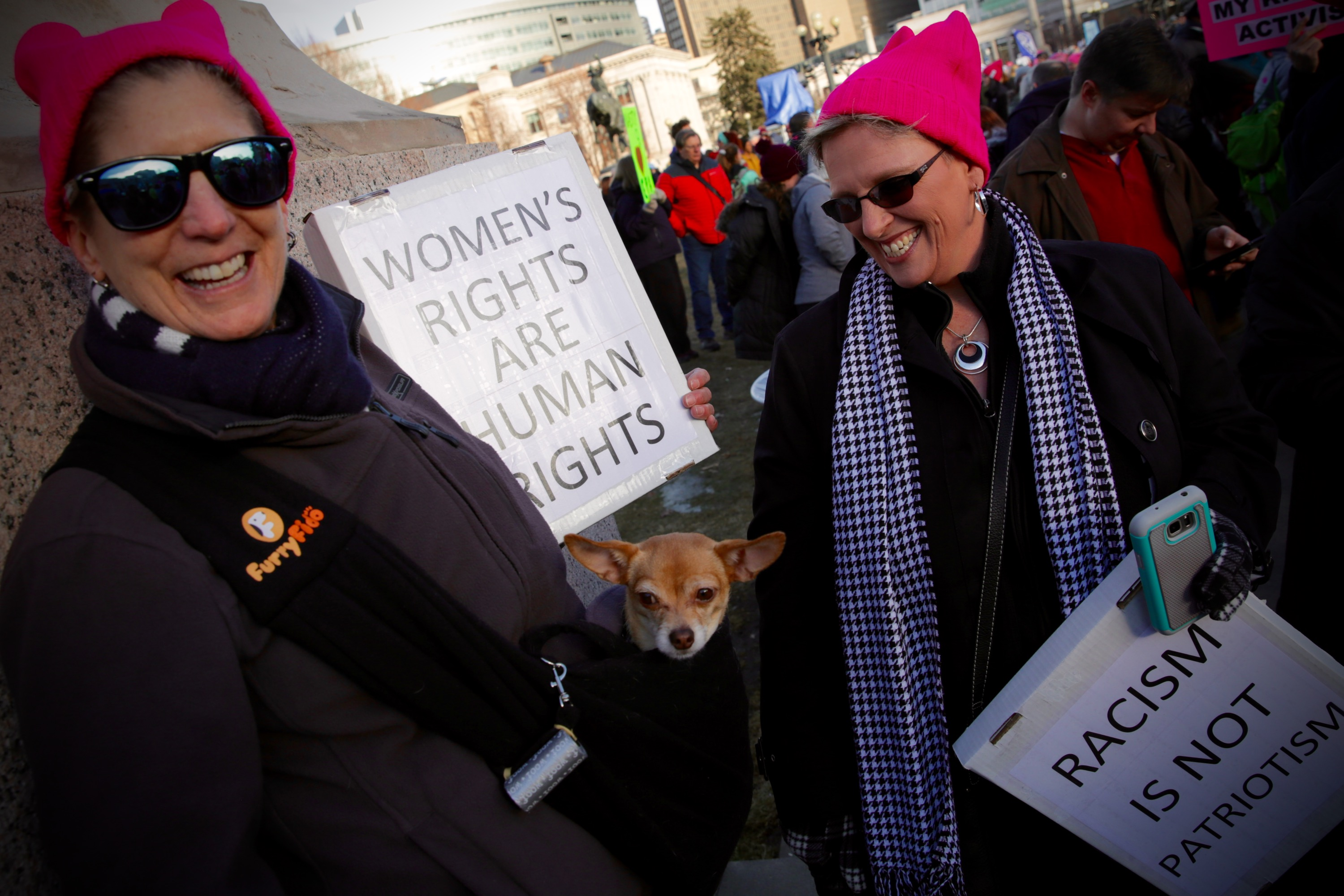 <p>Tracie Schmidt of Denver, at left, and her little dog Lola at the 2018 Women's March in Denver.</p>