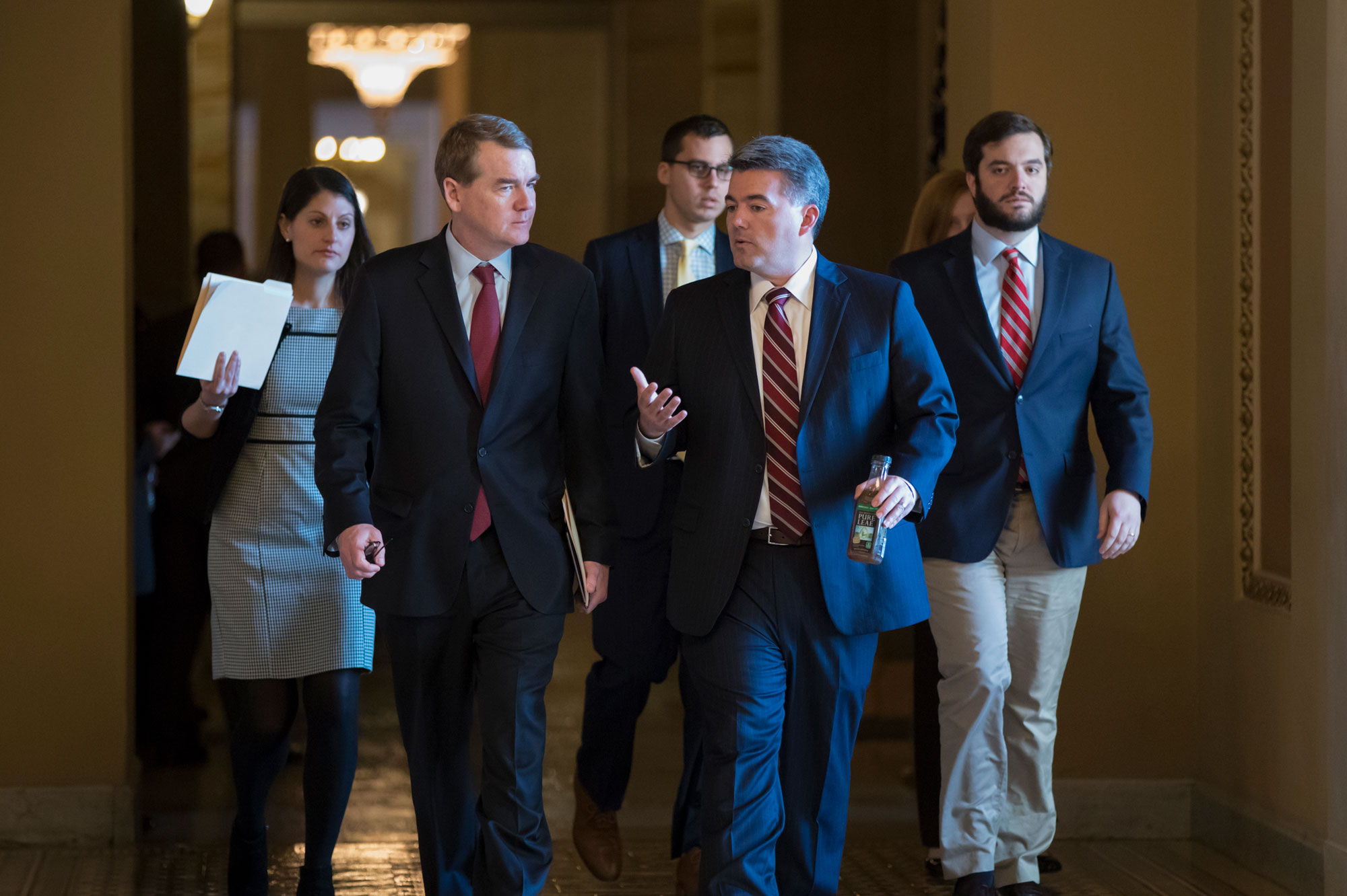 <p>Sen. Michael Bennet, D-Colo., left, and Sen. Cory Gardner, R-Colo., head to the chamber for a series of procedural votes on a bipartisan immigration deal, at the Capitol in Washington, Thursday, Feb. 15, 2018.</p>