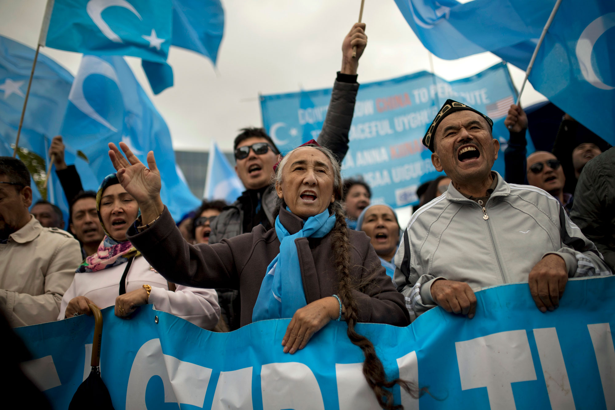 <p>Rebiya Kadeer, center, former head of the pro-independence World Uyghur Congress, shouts slogans with others holding Uyghur flags, or pro-independence of Eastern Turkistan, during a protest in Brussels, Monday, Oct. 1, 2018.</p>