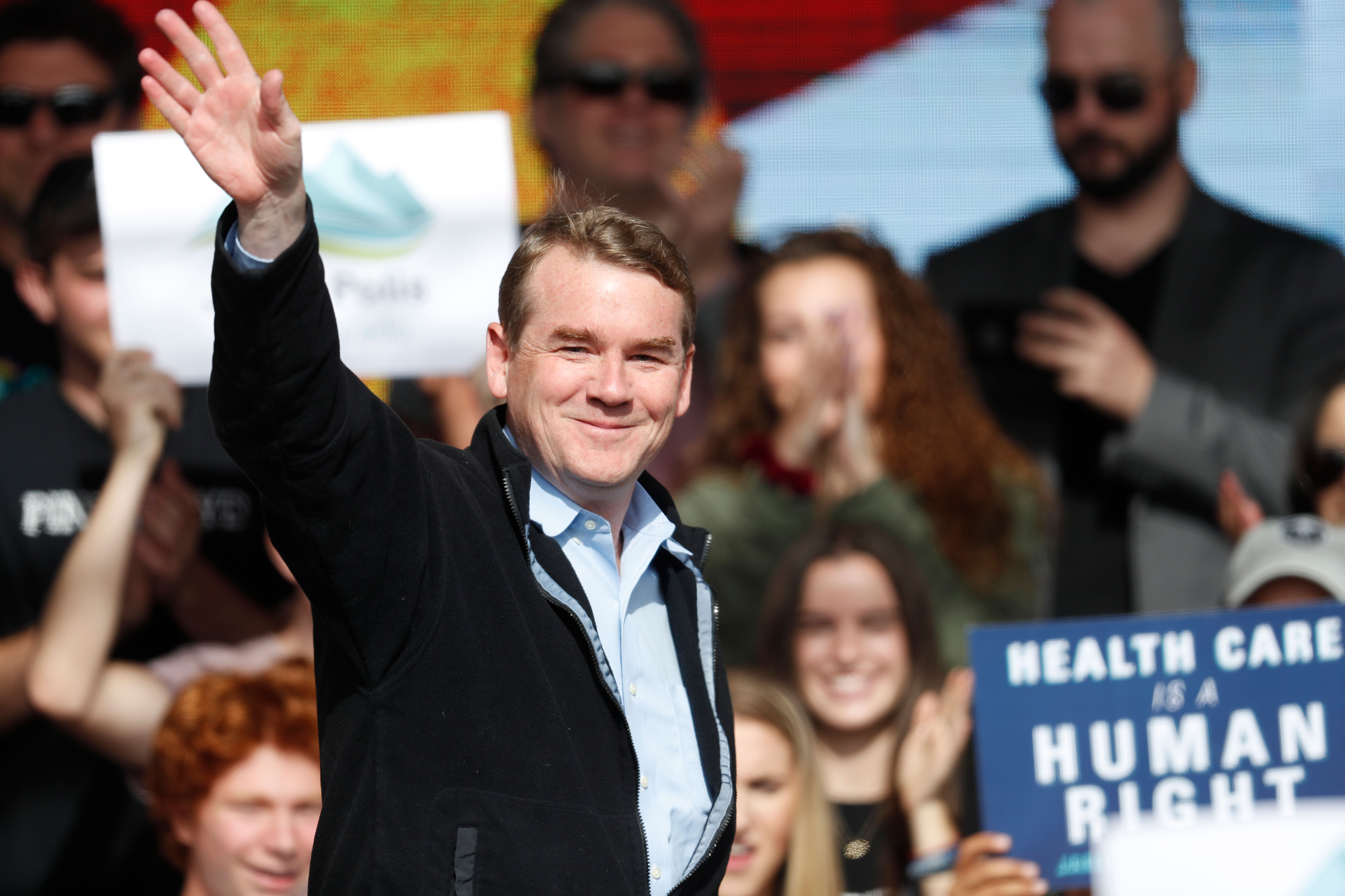 <p>Sen. Michael Bennet, D-Colo., greets voters before Sen. Bernie Sanders speaks during a rally with young voters on the campus of the University of Colorado Wednesday, Oct. 24, 2018, in Boulder, Colo.</p>