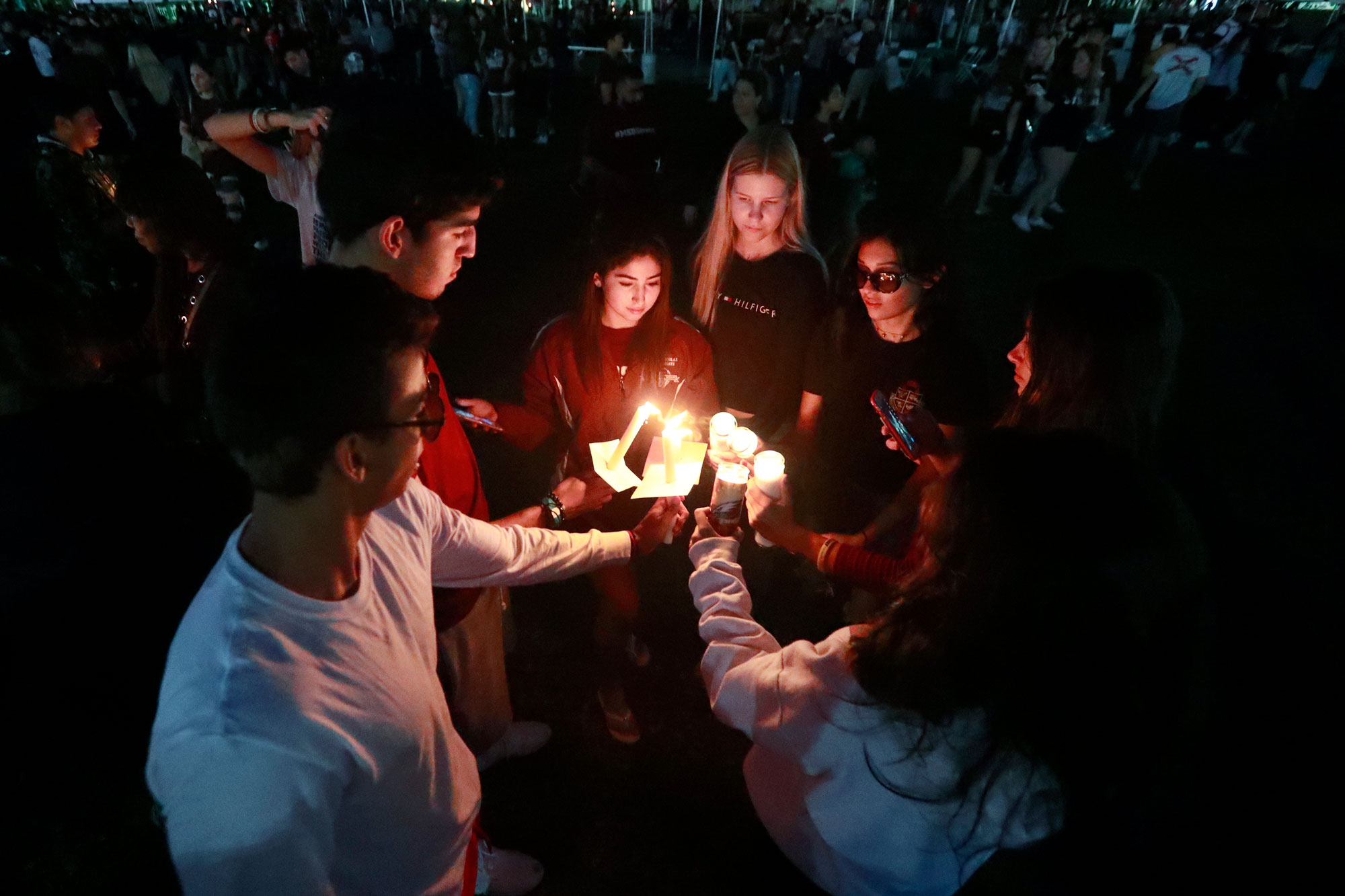 <p>Attendees during an interfaith service light candles, Thursday, Feb. 14, 2019, in Parkland, Fla.</p>