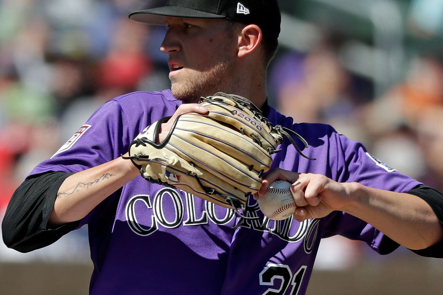 <p>A tattoo of mountains extends down the right arm of left-handed Colorado Rockies starting pitcher Kyle Freeland as he throws against the Cincinnati Reds in a spring training baseball game Monday, March 18, 2019, in Scottsdale, Ariz.</p>
