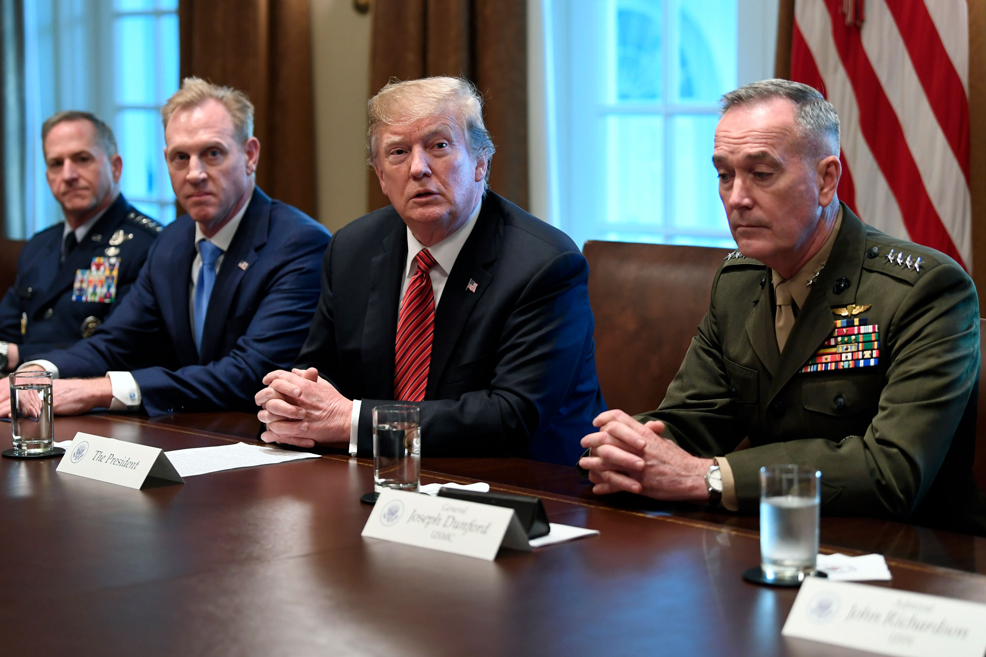 <p>President Donald Trump, second from right, flanked by acting Defense Secretary Patrick Shanahan, second from left, and Chairman of the Joint Chiefs of Staff Gen. Joseph Dunford, right, speaks during a meeting with military leaders in the Cabinet Room of the White House in Washington, Wednesday, April 3, 2019.</p>