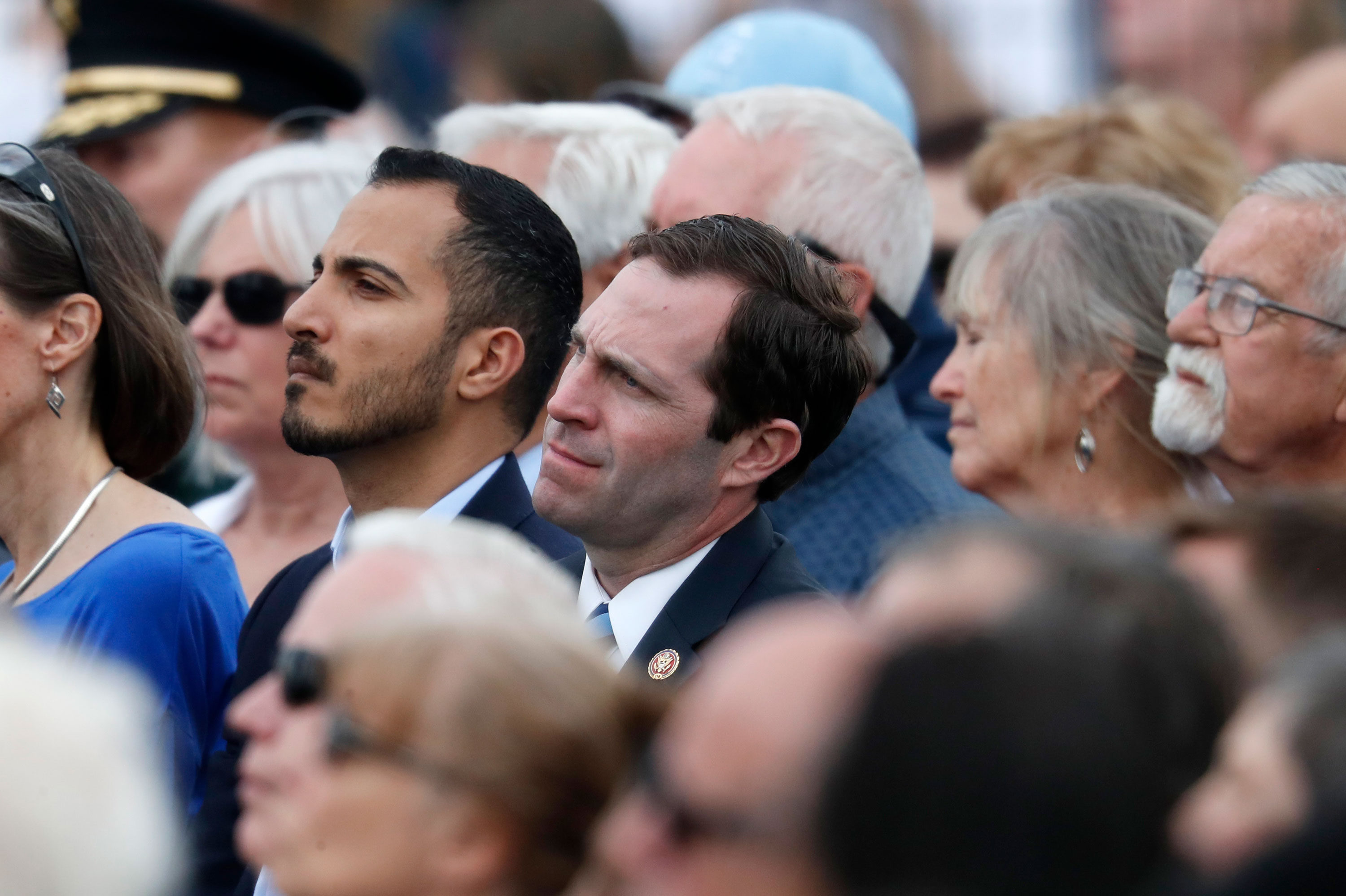 <p>U.S. Rep. Jason, Crow, D-Colo., center joins attendees during a program for the victims of the massacre at Columbine High School 20 years ago Saturday, April 20, 2019, in Littleton, Colo.</p>