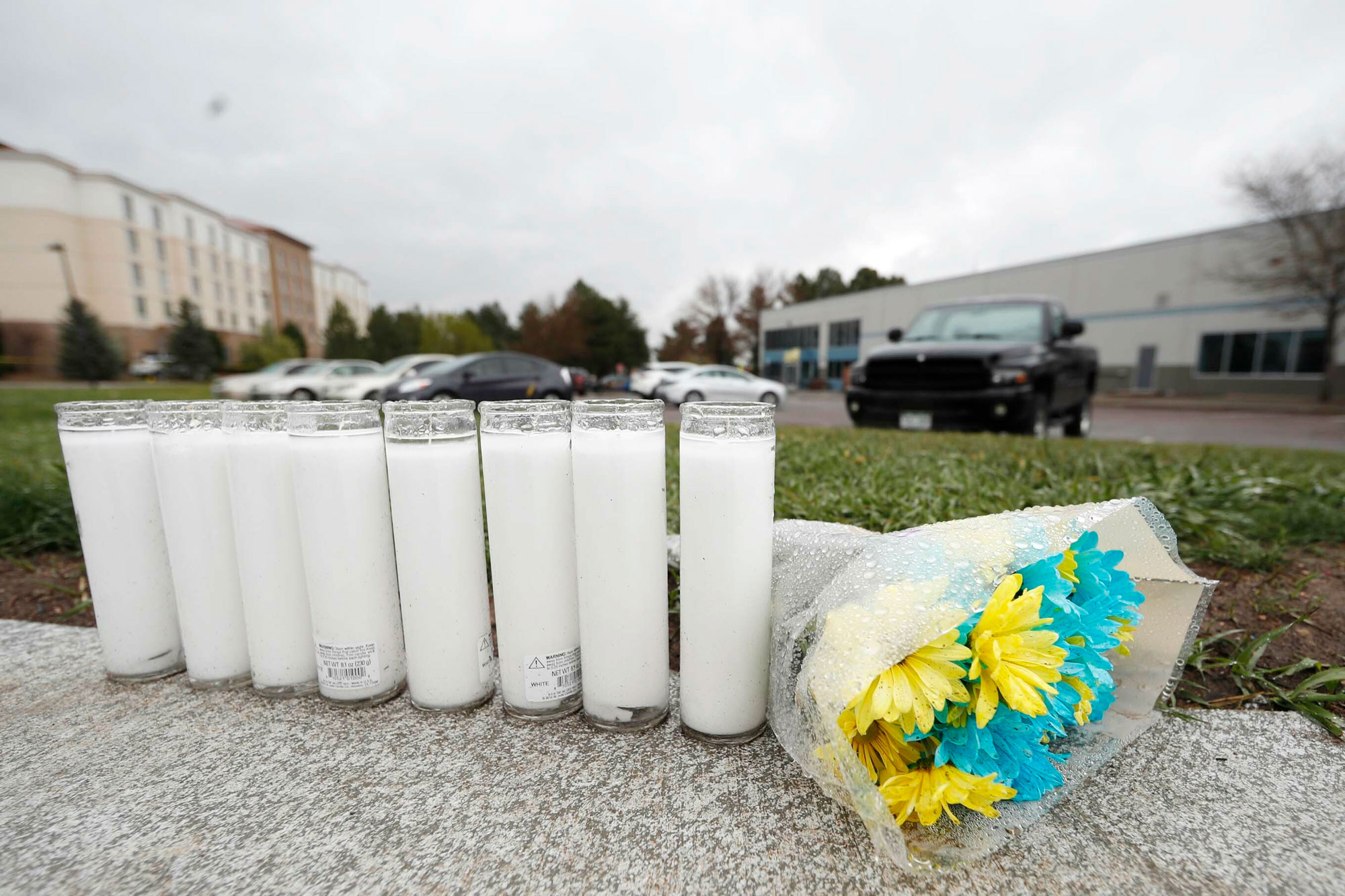 <p>A bouquet of flowers sits next to a row of candles outside the STEM School Highlands Ranch late Wednesday, May 8, 2019, in Highlands Ranch, Colo. A fatal shooting took place Tuesday at the charter school south of Denver.</p>