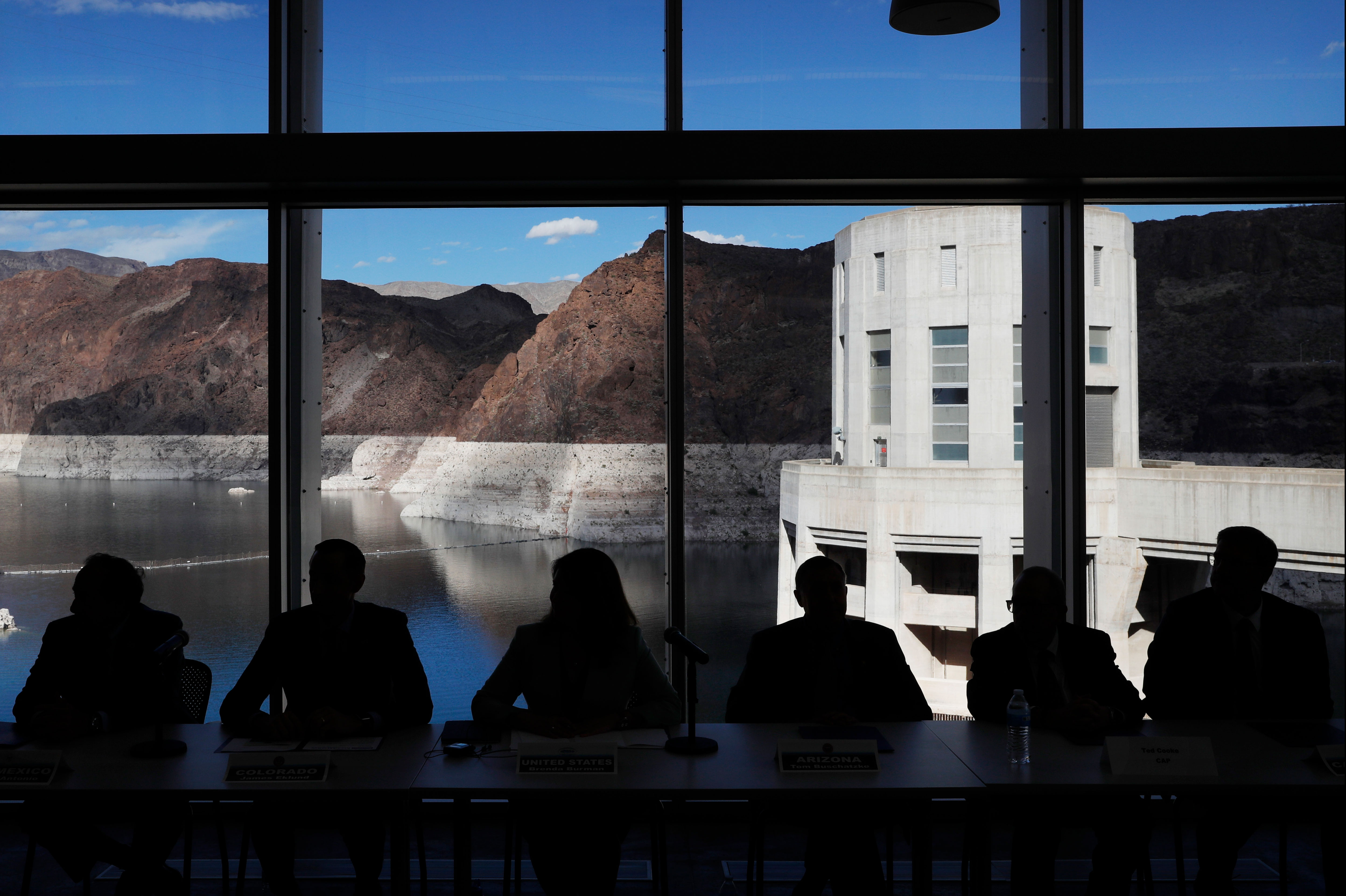 <p>Representatives from seven states and the federal government sit during a news conference at Hoover Dam before a ceremony for a Colorado River drought contingency plan, Monday, May 20, 2019, in Boulder City, Nev.</p>