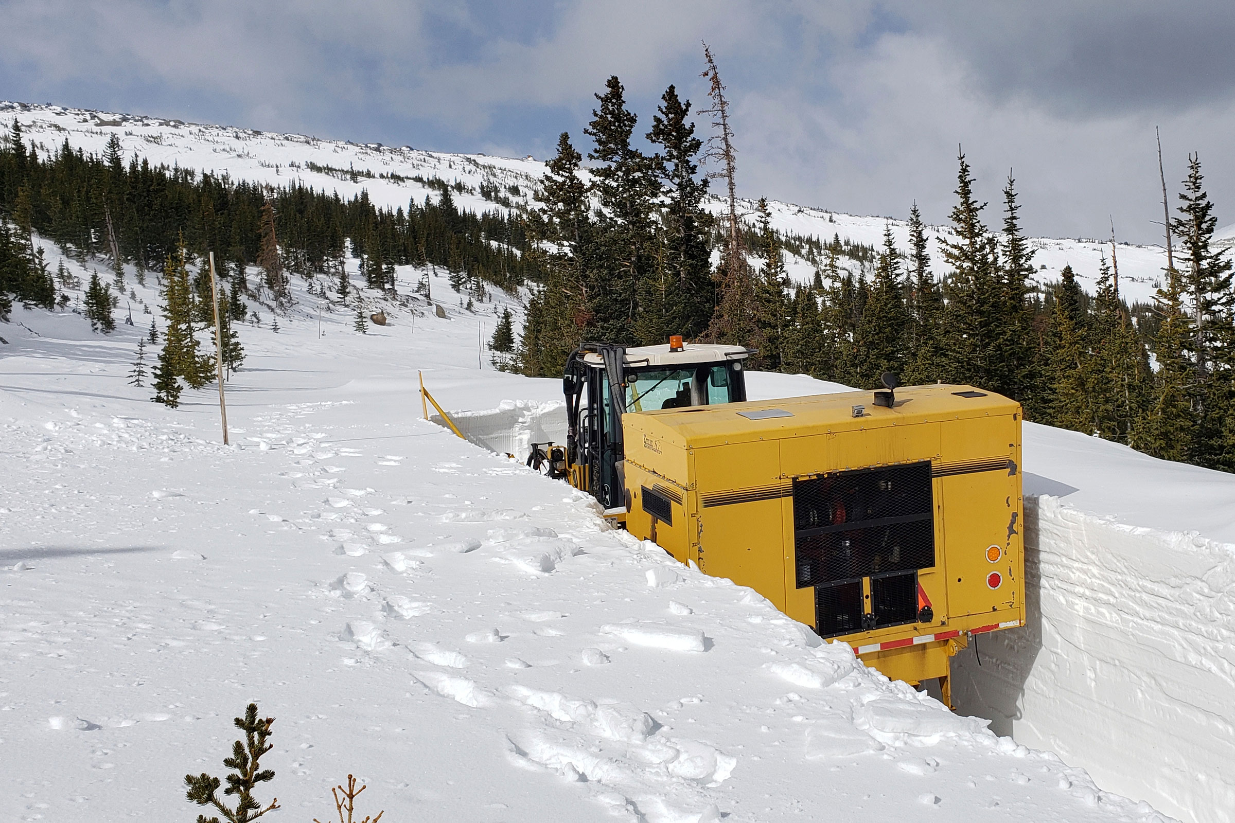 <p>This undated photo provided by the National Park Service shows a snowplow on Trail Ridge Road in Rocky Mountain National Park, Colo., in late April.</p>