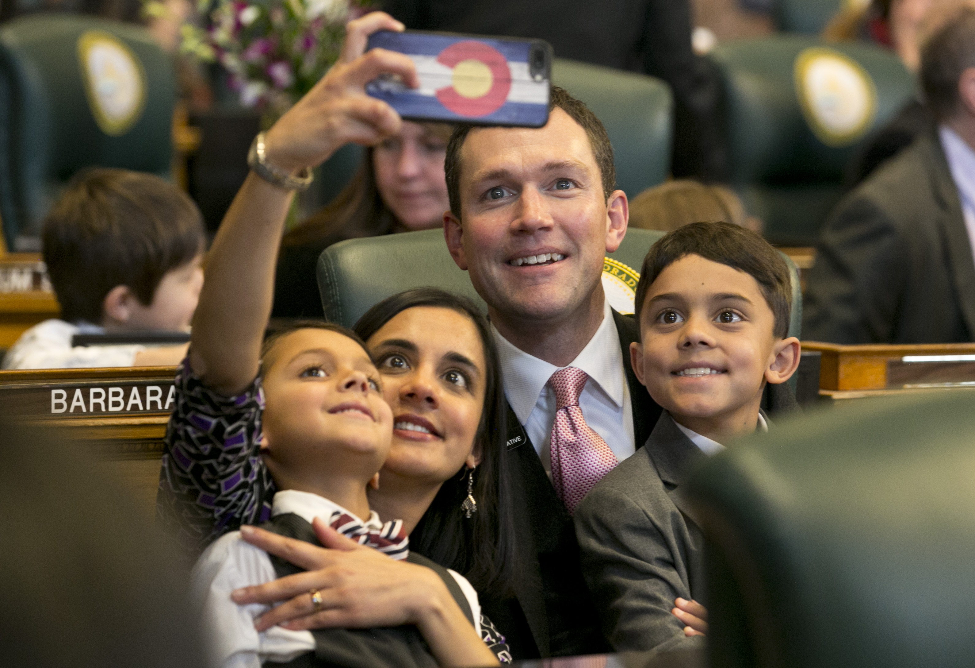 <p>Rep. Chris Hansen, D-Denver, and his wife Ulcca take a selfie with their kids Ashwin and Sachin at the Colorado state Capitol on Wednesday, Jan. 11, 2017.</p>
