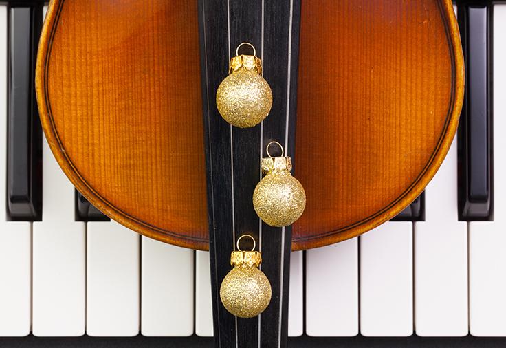 Piano keyboard,old violin and Christmas decoration