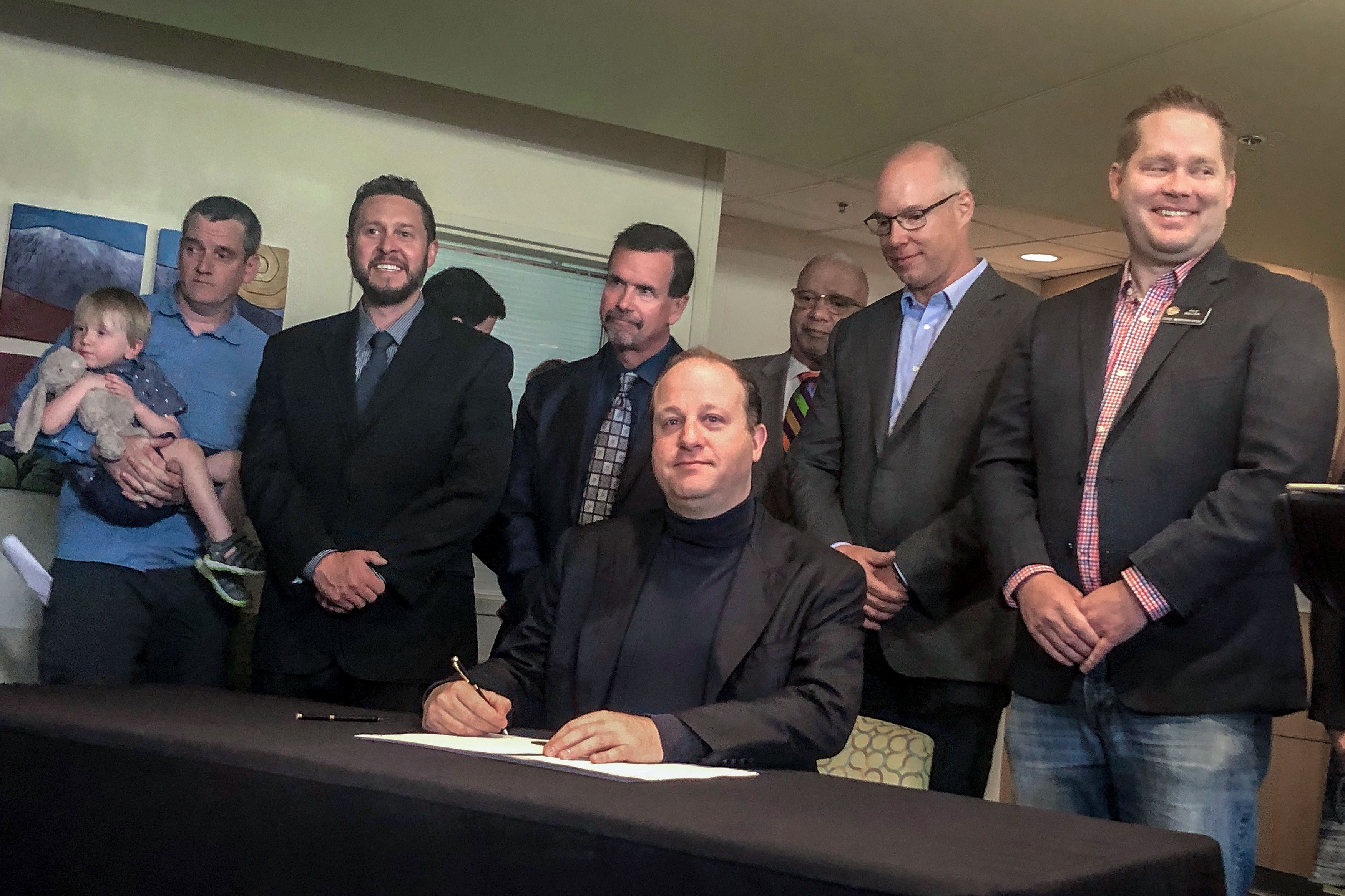 <p>Gov. Jared Polis signs an executive order that hopes to increase the Colorado's MMR vaccination rate amongst kindergarteners, June 13, 2019.</p>