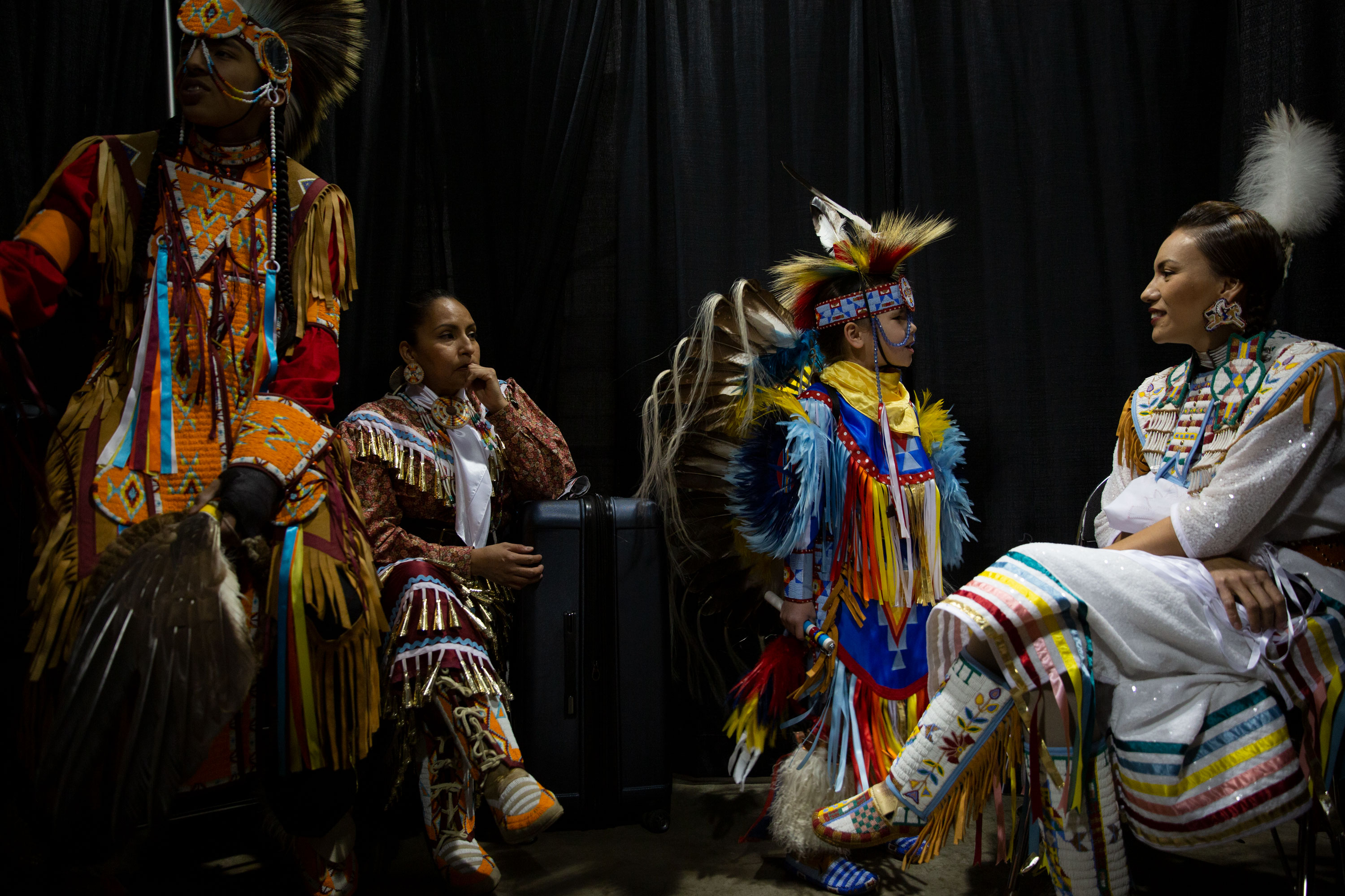 "<p>(L-R) Wambdi Clairmont, Kiva Trujillo, <span style=""color: rgb(64, 69, 64);"">Omani Denny </span>Clairmont and Tanksi Clairmont wait backstage at the Denver Travel & Adventure Show at the Colorado Convention Center on Feb. 23, 2019. The dancers will perform at the Denver March Pow Wow March 22-24.</p>"
