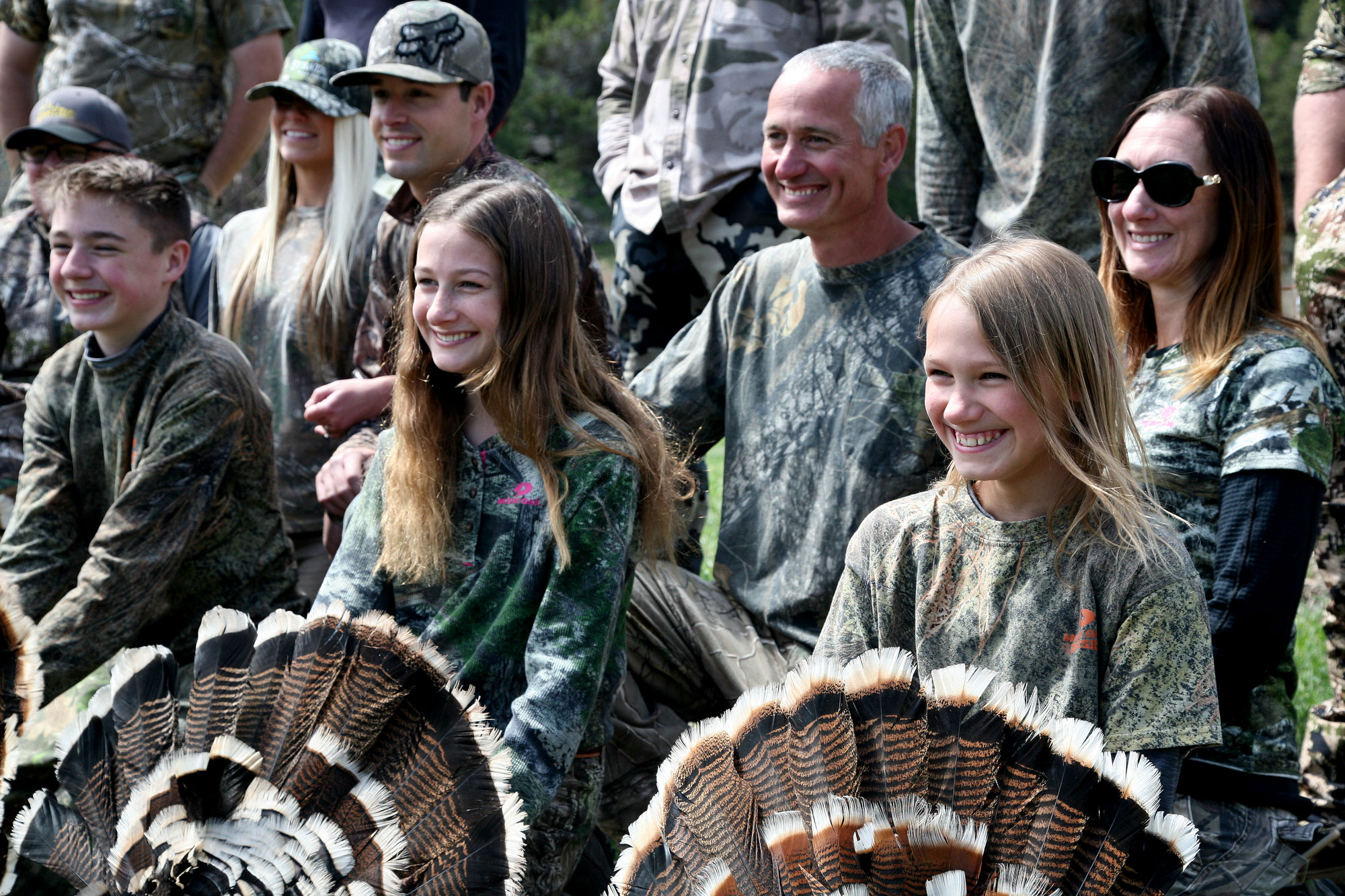 <p>This year was a bountiful one for the annual Colorado Parks and Wildlife Youth Hunter Outreach Program turkey hunt, with six out of seven youngsters taking a turkey. From left, Hunter Snow, 14, and sisters Savannah and Hailey Jones, ages 13 and 11. Behind, from left, are parents Amber and Andy Snow, and John and Jenny Jones.</p>