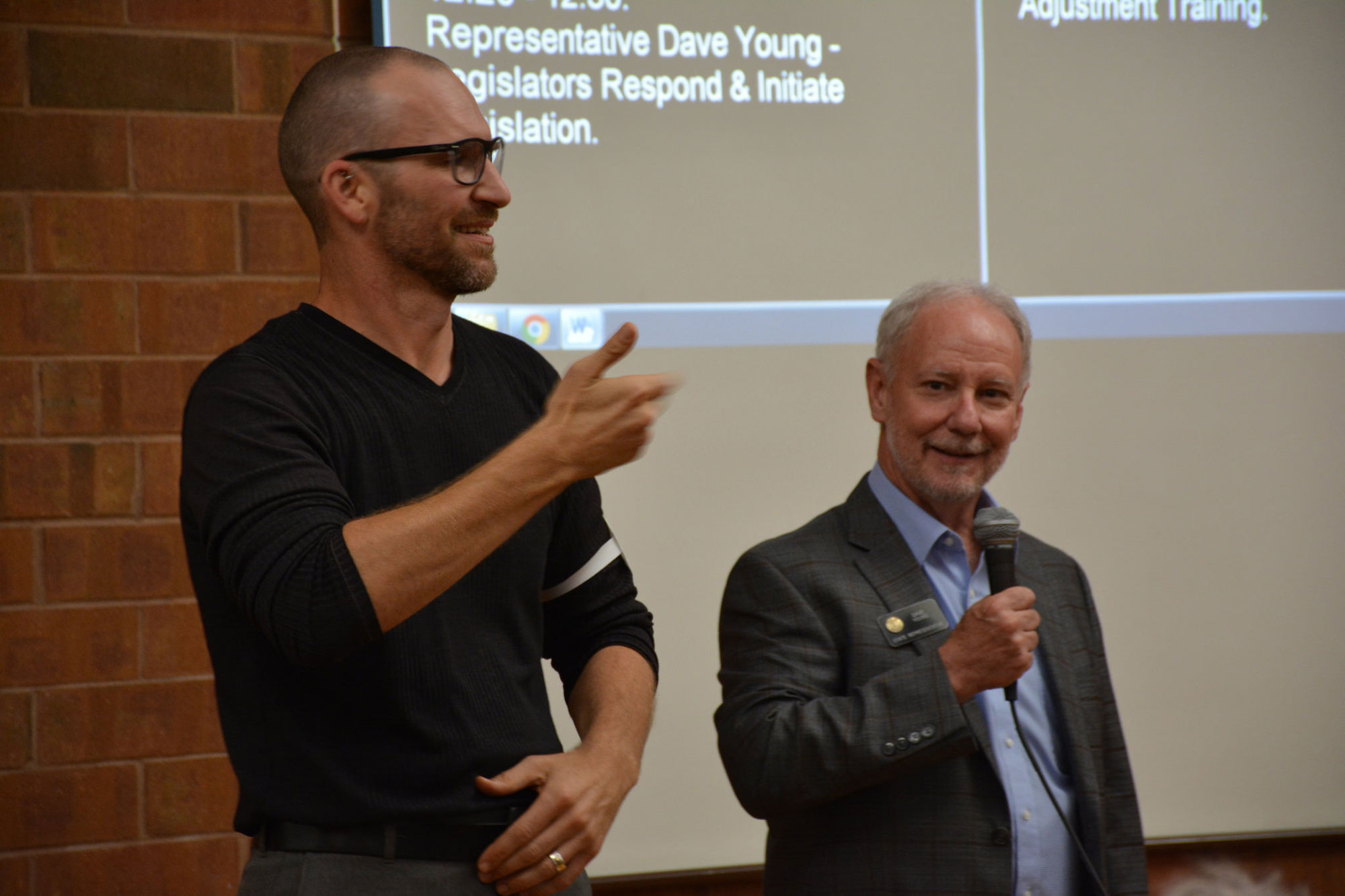 <p>Certified ASL interpreter Kirk Neuroth translates for State Treasurer (then-state Rep.) Dave Young at a public meeting.</p>