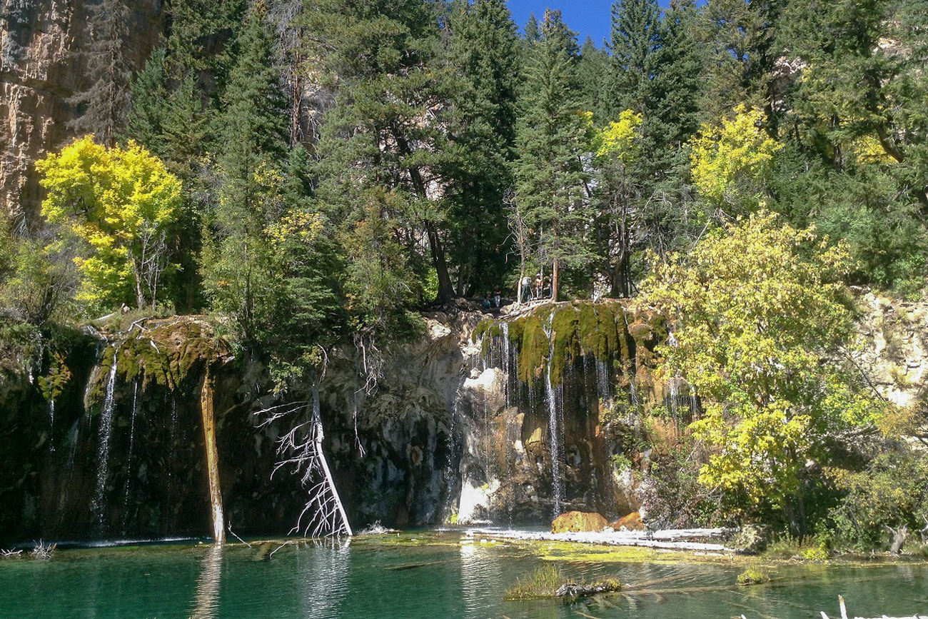 Hanging Lake, near Glenwood Springs, Colo., is one of the state's most popular — and crowded — outdoor attractions. A new shuttle and permit system hopes to alleviate the strain.