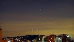 Helio C. Vital captured Mercury and Mars over Rio de Janeiro, Brazil, on June 9, when they were about 7 degrees apart. Beginning around now, they should fit in a single binocular field. They'll be much closer – 0.2 degrees apart – on June 18.