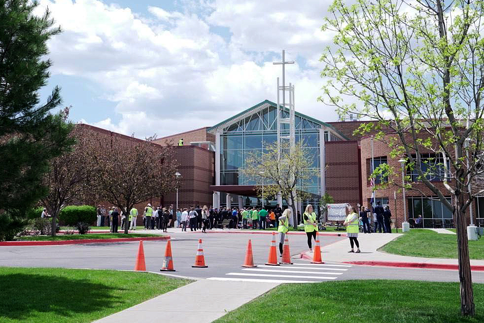 <p>People gather outside Cherry Hills Community Church ahead of a celebration of life for Kendrick Castillo, the student killed in the STEM School shooting, on Wednesday, May 15.</p>