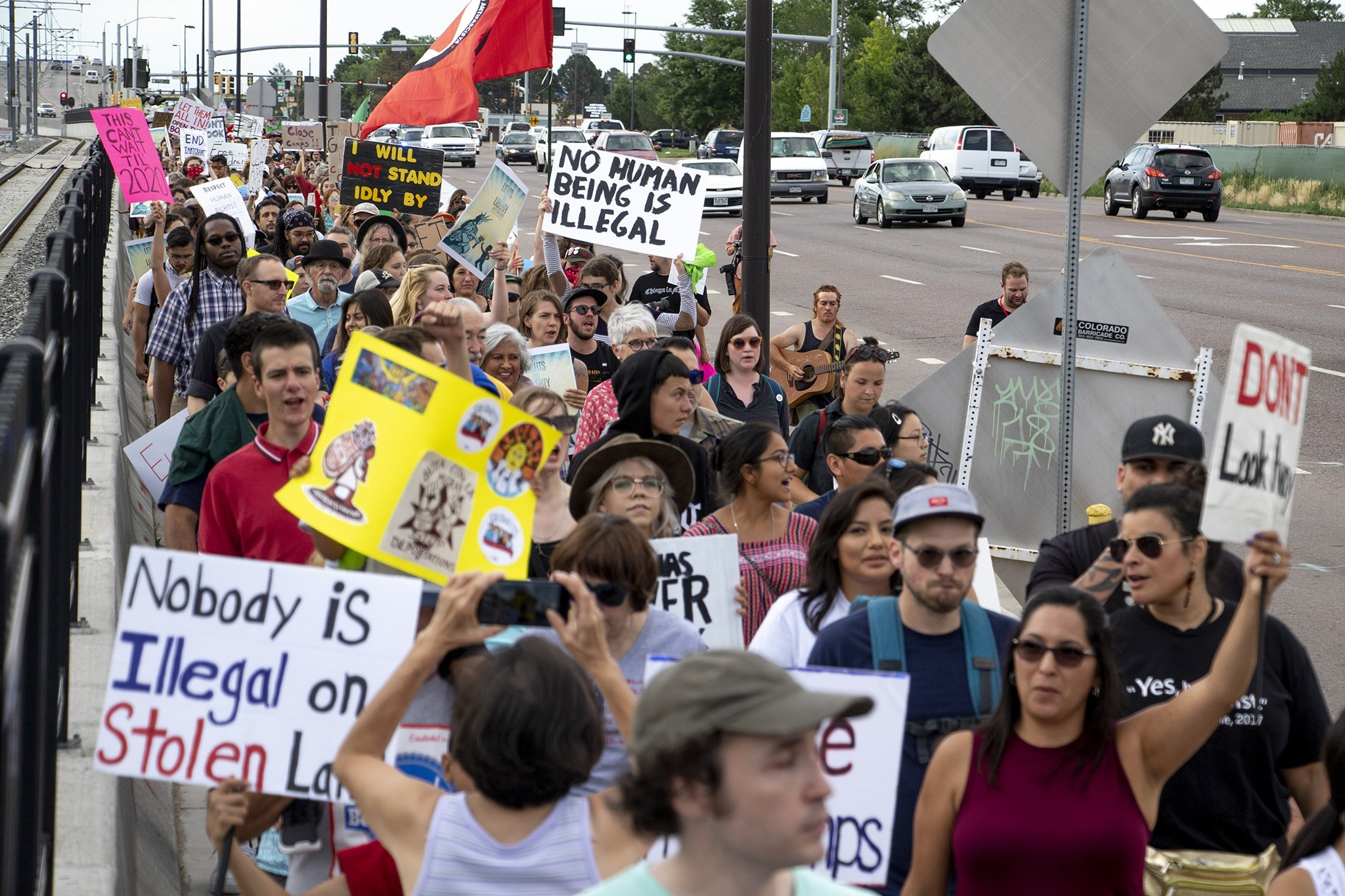 Protesters gather outside of Aurora's private immigration detention facility to denounce ICE raids and jails like this across the country, June 14, 2019.