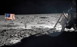 Apollo 11 Commander Neil Armstrong working at an equipment storage area on the lunar module. This is one of the few photos that show Armstrong during the moonwalk.