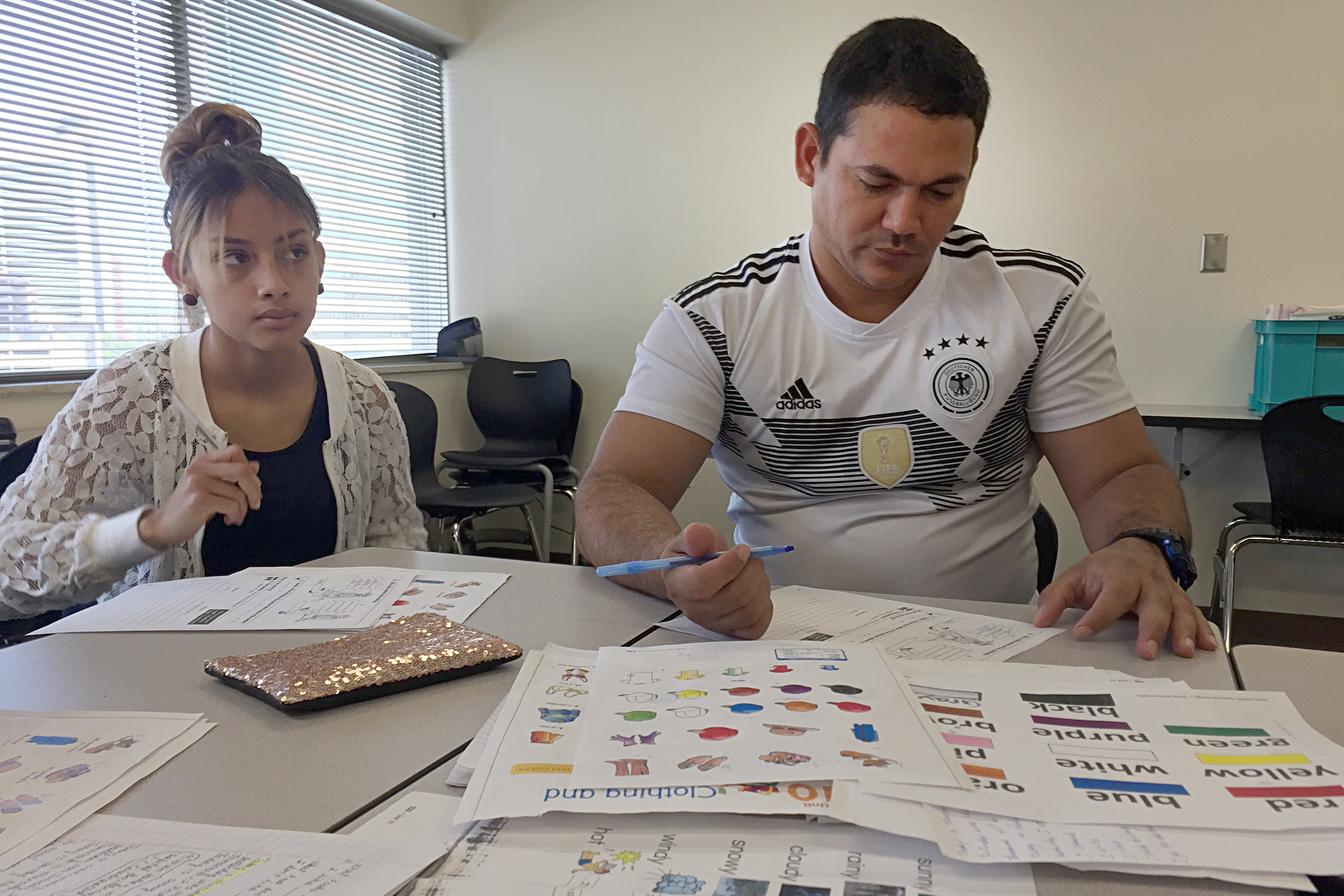 Two students in an Emily Griffith Technical College refugee literacy class in downtown Denver work on words for clothes and colors. The English language school teaches immigrants at all skill levels.