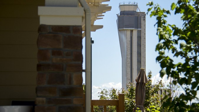 The defunct Stapleton Airport control tower looms over the growing suburban landscape.