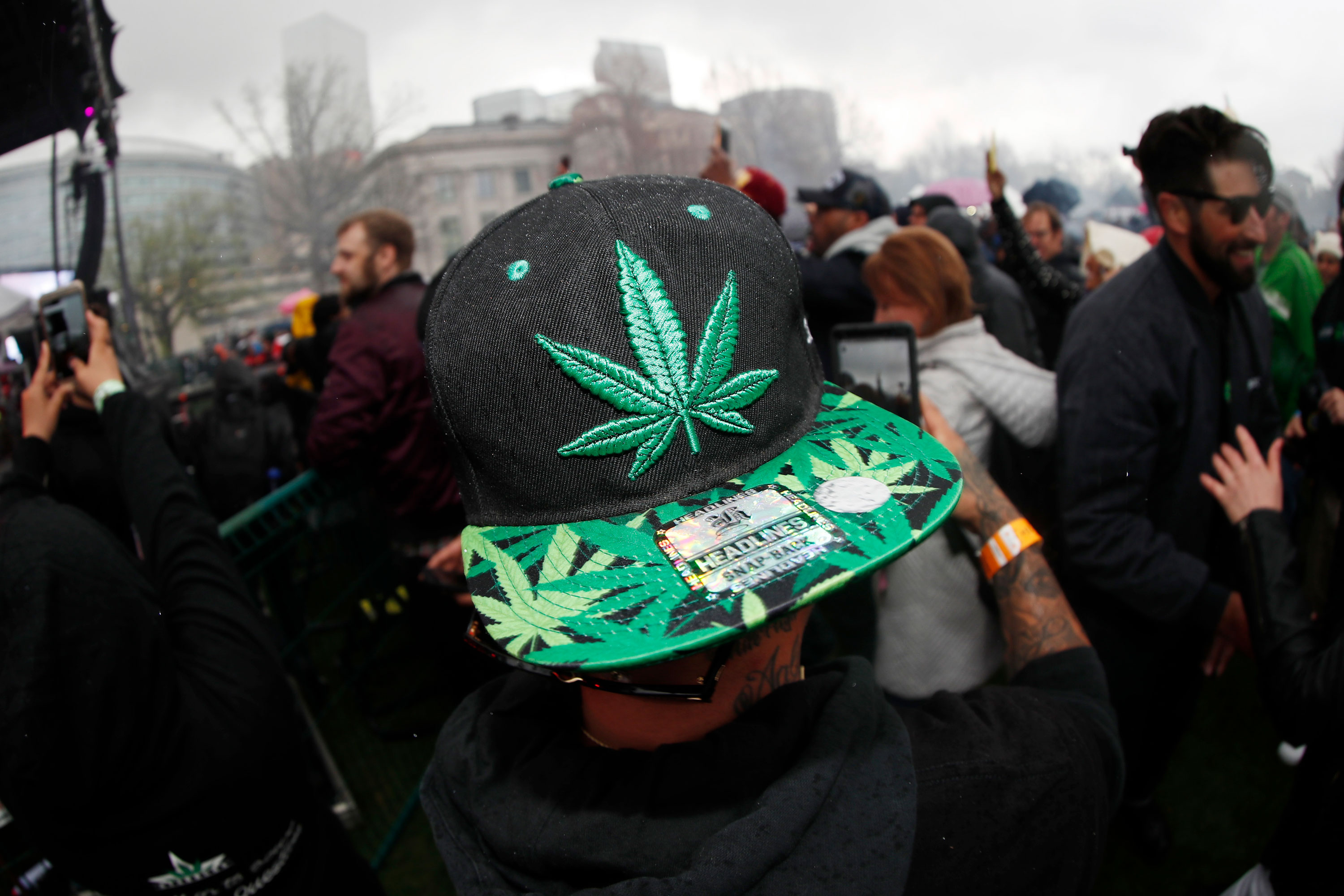 In this April 20, 2018 file photo, an attendee celebrates at 4:20 p.m. by lighting up marijuana during the Mile High 420 Festival in Denver. New research has found some Colorado teenagers who use marijuana are shifting away from smoking it in favor of edible products.